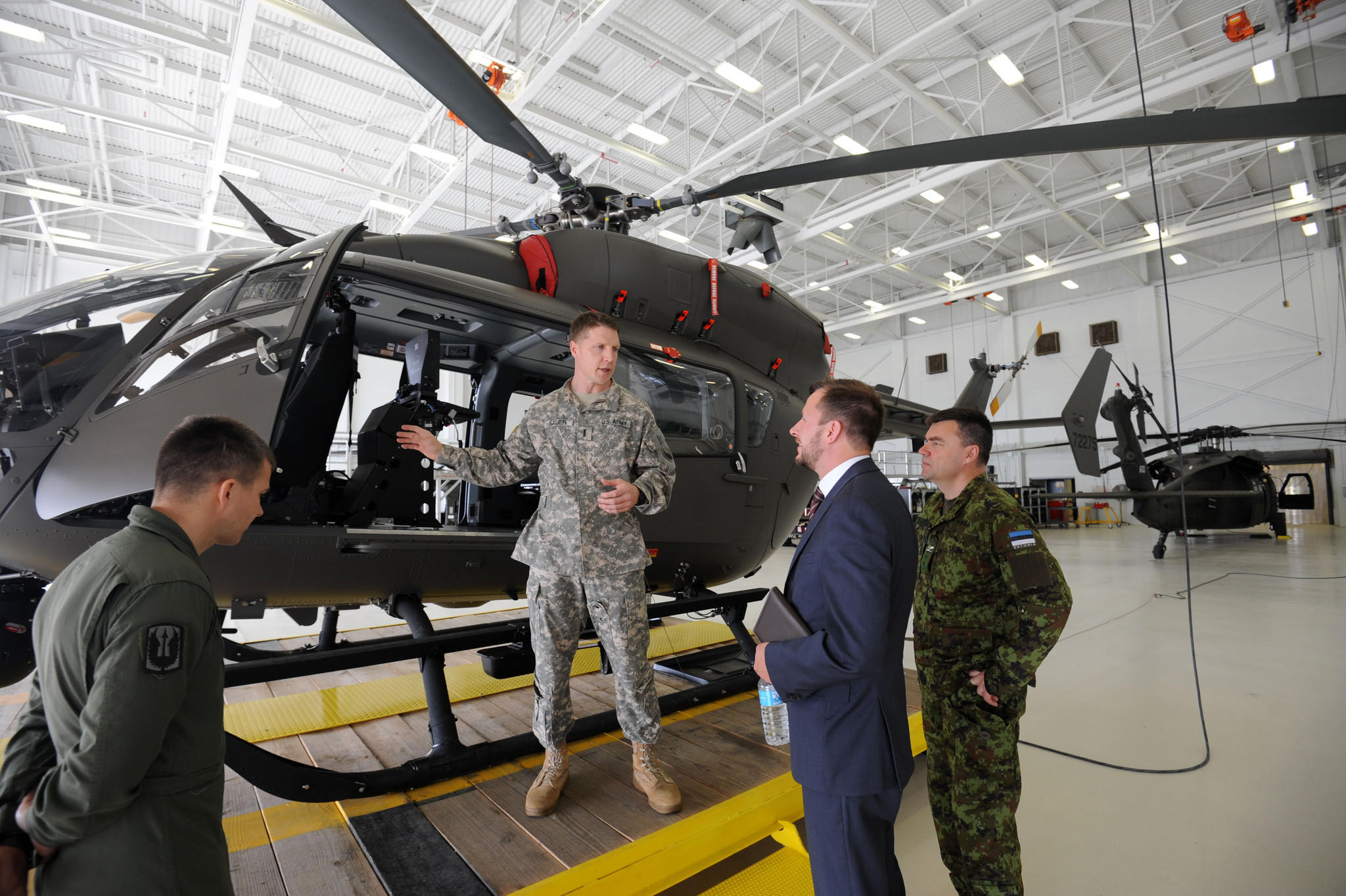Scott Sauer (left), of the Maryland National Guard, talks about the LUH-72 Lakota helicopter as Tanel Sepp, deputy chief of mission, and Col. Aivar Salekesin, Estonian defense attache listen.