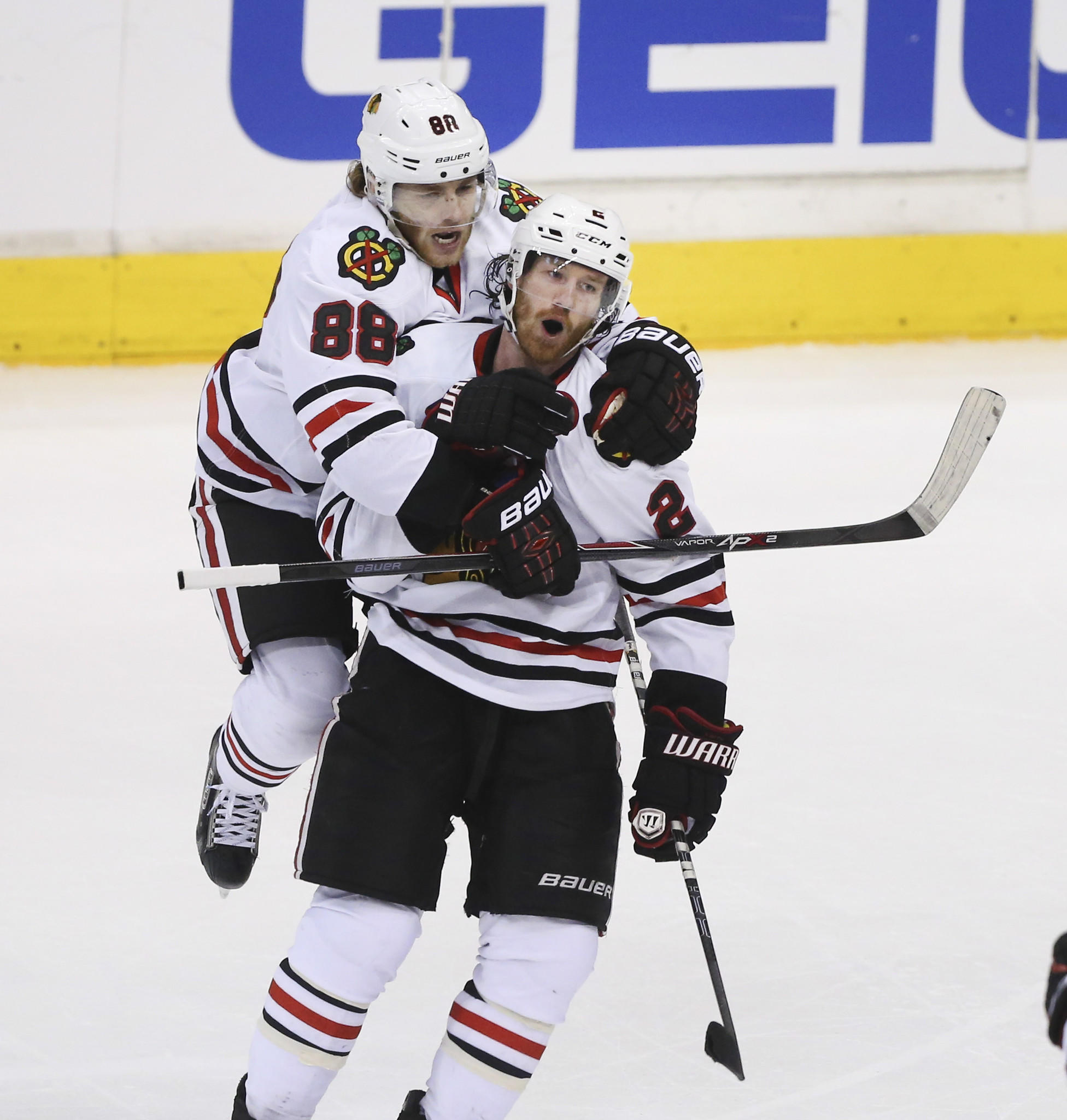 Patrick Kane (88) and Duncan Keith celebrate during Game 6.