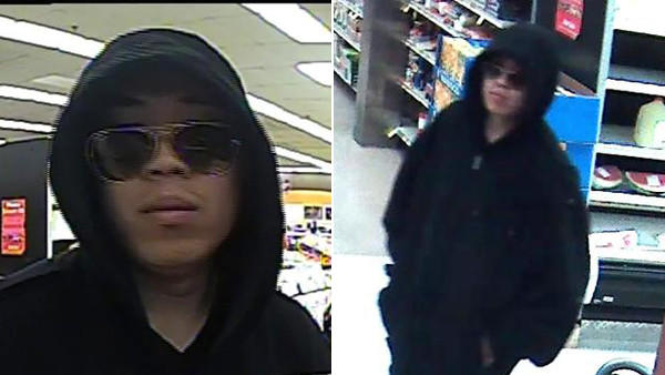 Surveillance photos of a man wanted in connection with the robbery of a North Side bank Sunday.