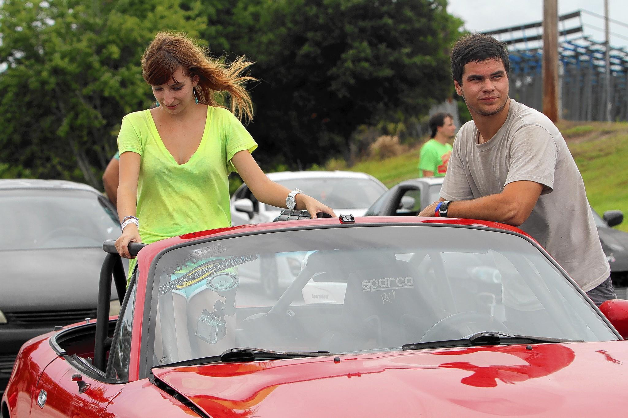 Driver Douglas Dircks, along with his girlfriend, Elisabath Pomeroy, waits in line to take his car on a drift at the oval track at Orlando Speed World.