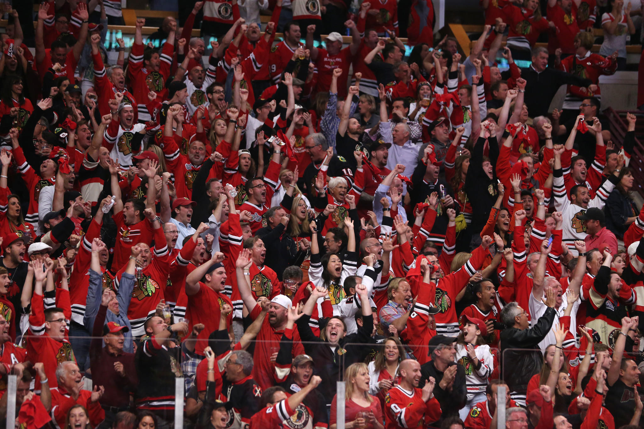 Blackhawks fans react to a goal by left wing Patrick Sharp in the second period of Game 7.