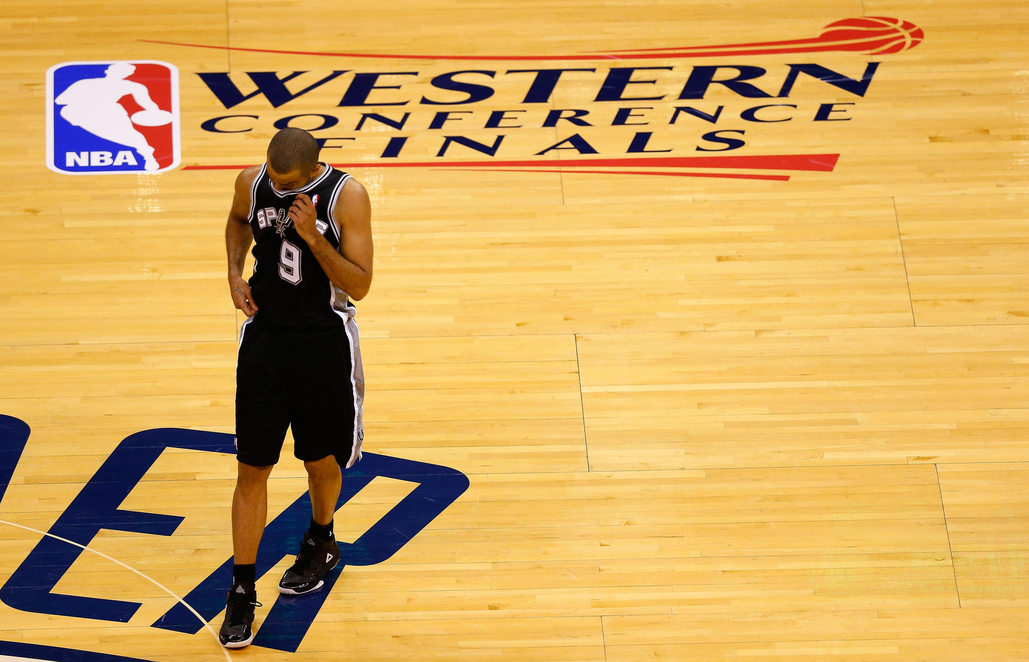 Tony Parker of the San Antonio Spurs walks across the court in the first half of Game 6 against the Oklahoma City Thunder.