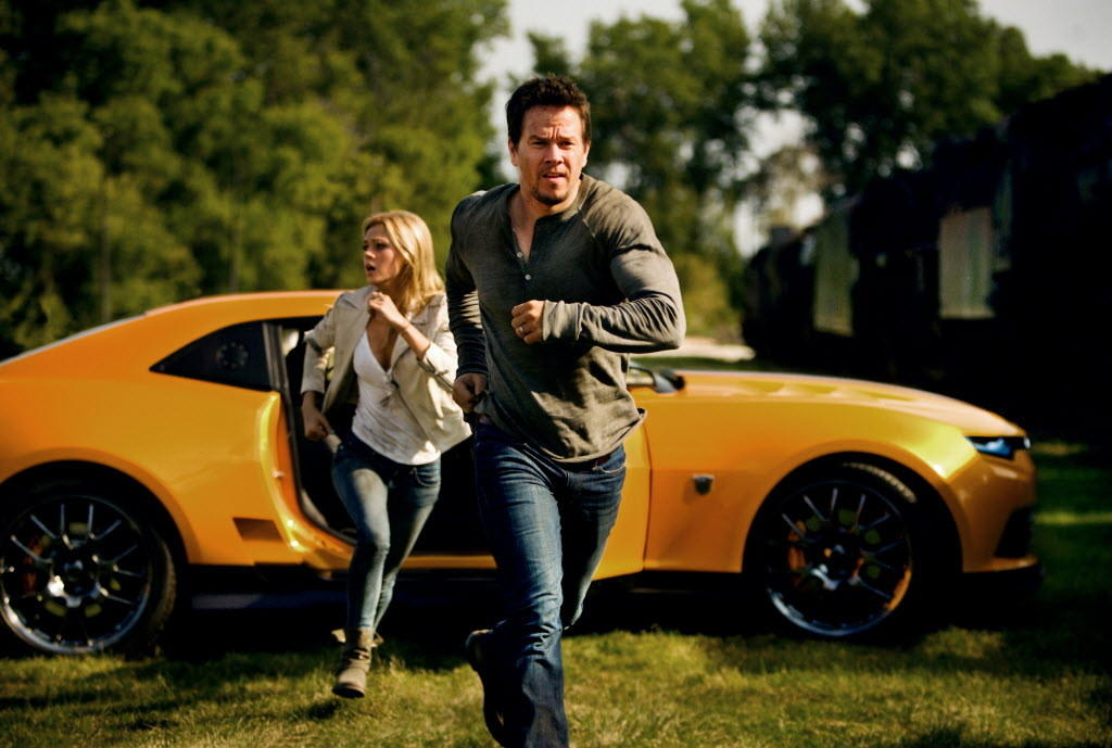 "Mark Wahlberg (right) and Nicola Peltz (left) star in ""Transformers: Age of Extinction."""