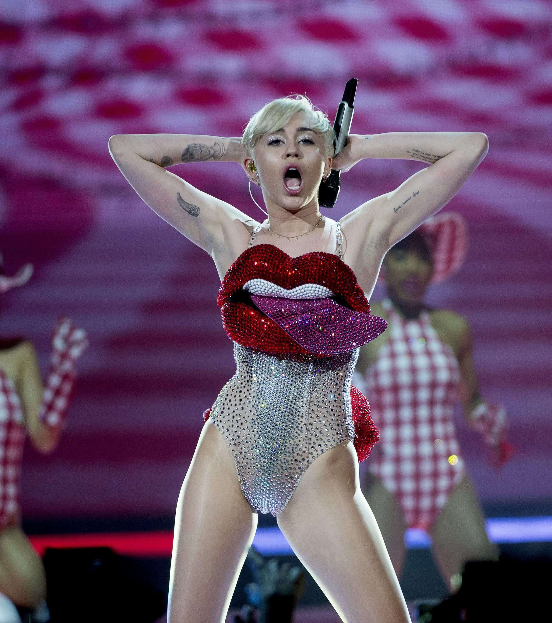 Miley Cyrus performs during her concert at the Ericsson Globe Arena in Stockholm, Sweden, on May 30, 2014.