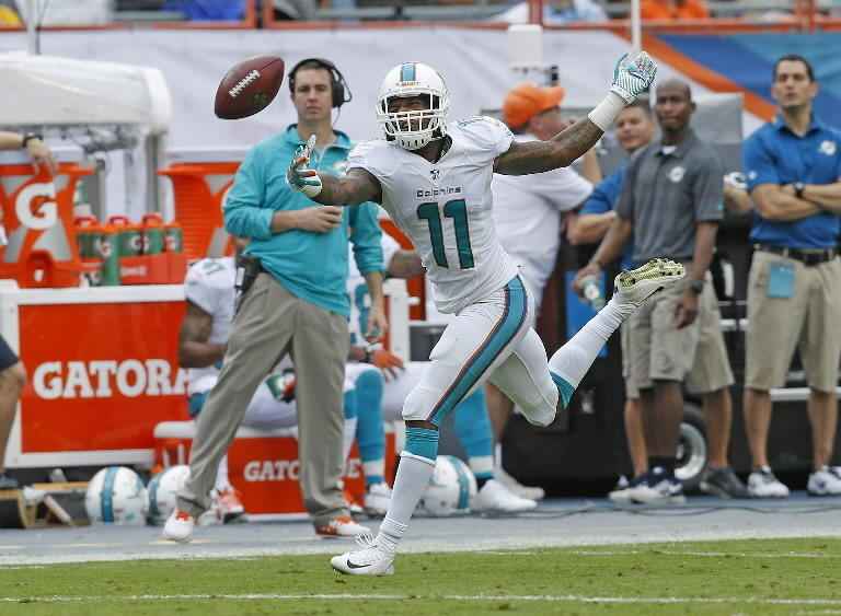 Mike Wallace #11 is unable to catch the ball thrown by Ryan Tannehill #17 (not pictured) of the Miami Dolphins during second quarter action against the New York Jets on December 29, 2013 at Sun Life Stadium in Miami Gardens, Florida. (Photo by Joel Auerbach/Getty Images)