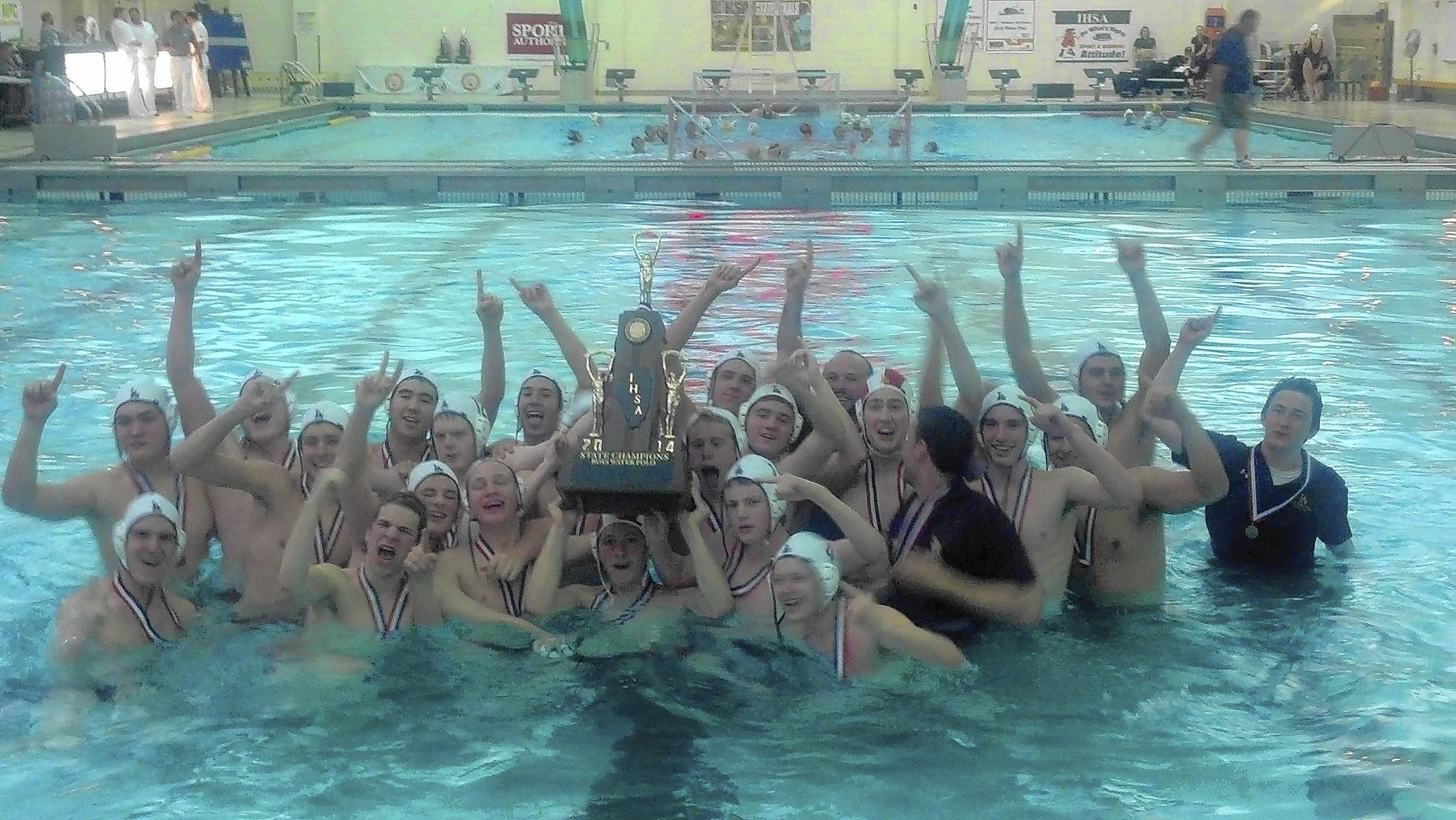 The Loyola boys water polo team poses with its state championship trophy on Saturday in Lincolnshire.