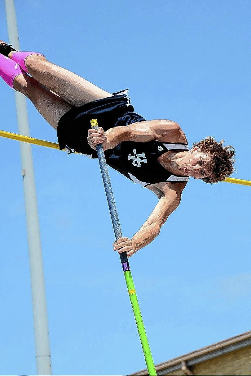 Highland Park High School pole vaulter Eddie Smoliak clears the bar on his way to a fifth-place finish at the state meet.