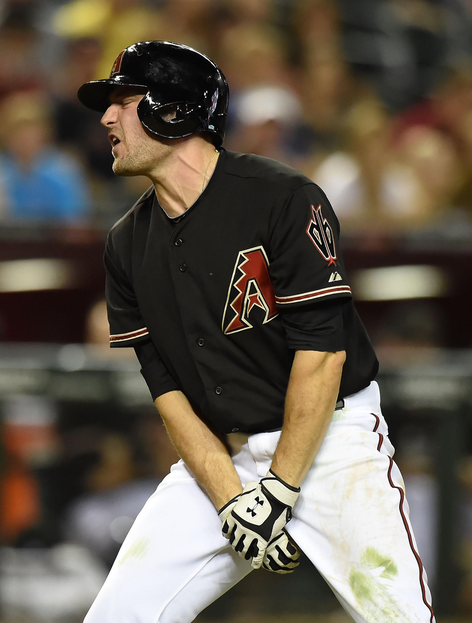 PHOENIX, AZ - MAY 31: AJ Pollock #11 of the Arizona Diamondbacks holds his hand after getting hit by a pitch in the eighth inning against the Cincinnati Reds at Chase Field on May 31, 2014 in Phoenix, Arizona. (Photo by Norm Hall/Getty Images) ORG XMIT: 477584185