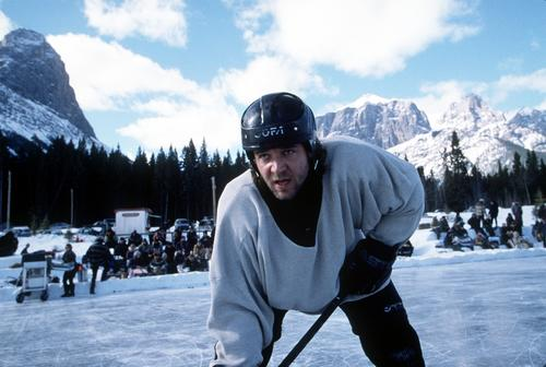 """Russell Crowe learned how to take a wrist shot for """"Mystery, Alaska,"""" in which a ragtag team goes up against the New York Rangers. He joined the likes of Paul Newman and John Wayne (1937's """"Idol of the Crowds"""") as big stars to lace up the skates for a role."""