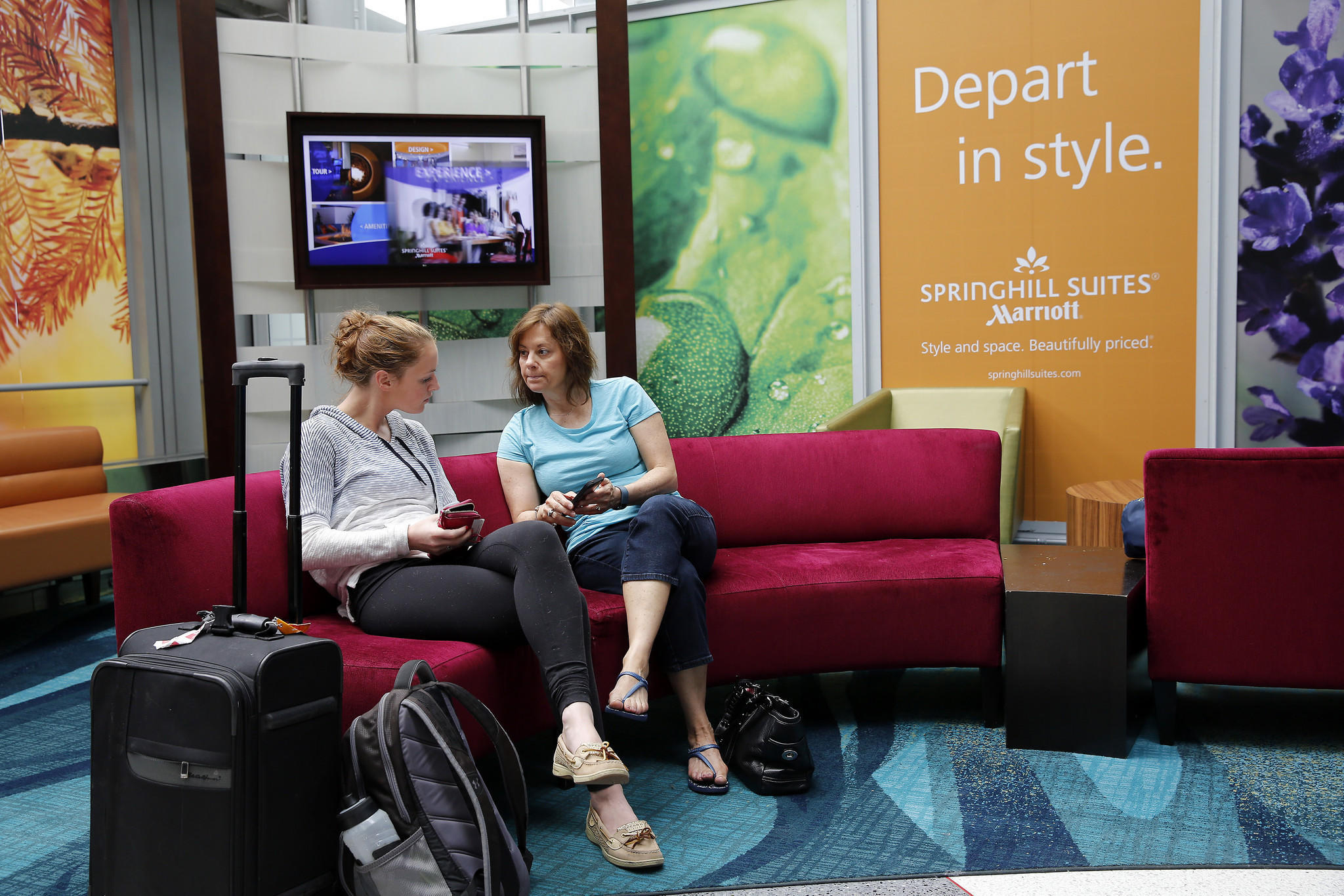 Kaitlyn King, left, and her mother Donna King sit on one of the comfortable, living room furniture style seating in the pre-security area at O'Hare International Airport terminal 1.