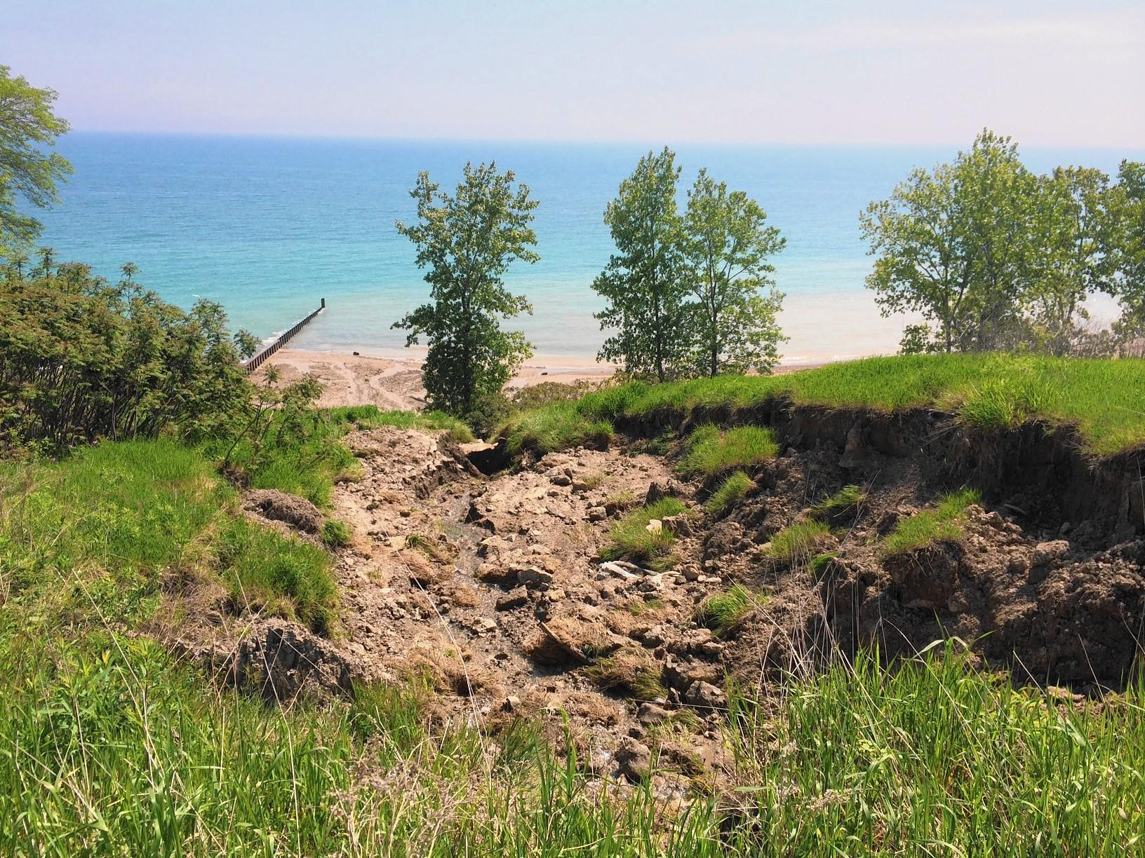 A 40-yard-long swath of lake bluff at Fort Sheridan collapsed into Lake Michigan this week. Lake County Forest Preserves officials hope to determine the exact cause and prevent further erosion.