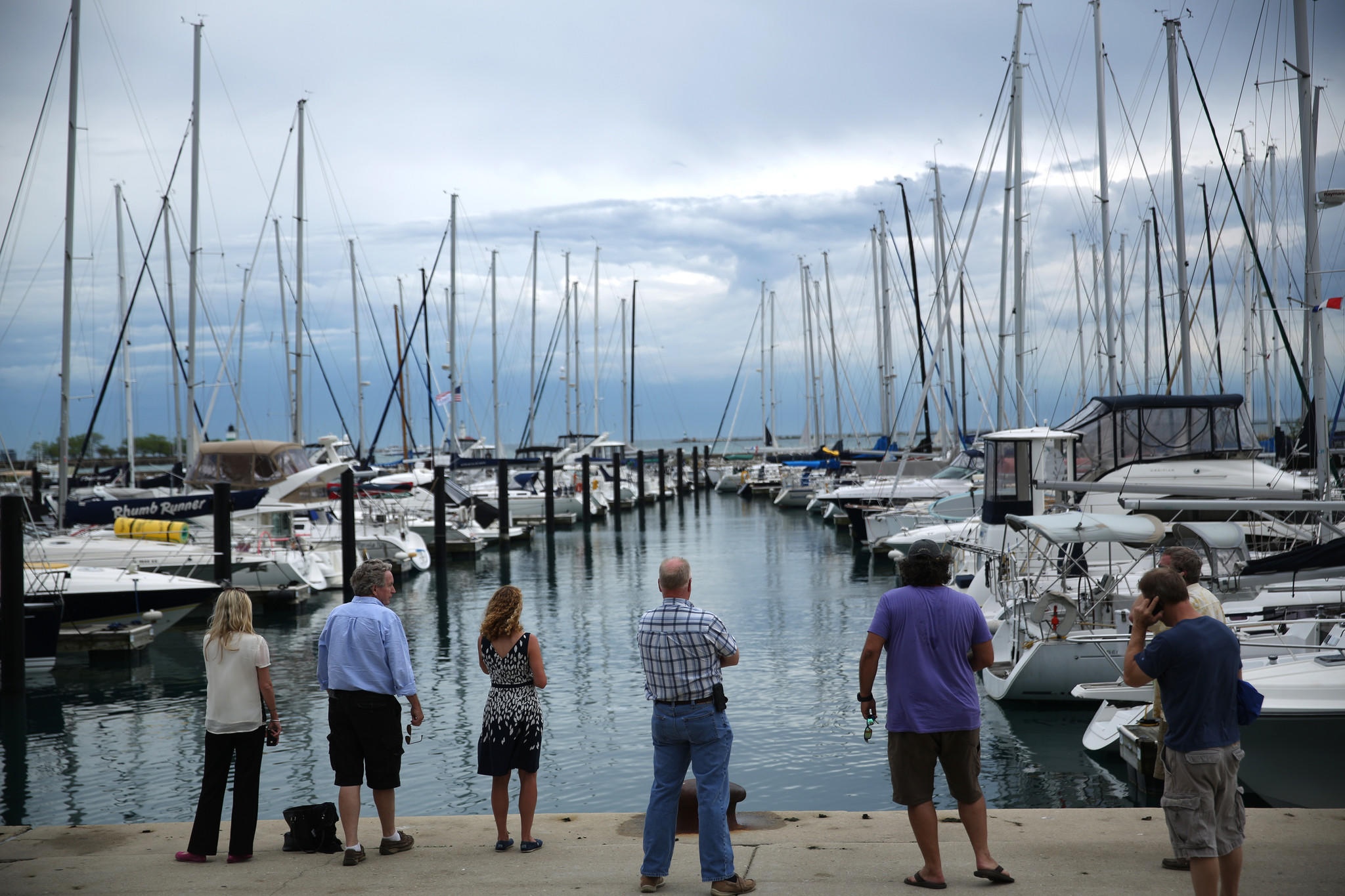 Boat owners watch as a pier (at right) drifts toward another row of boats after being damaged by a sudden storm at DuSable Harbor on Monday.