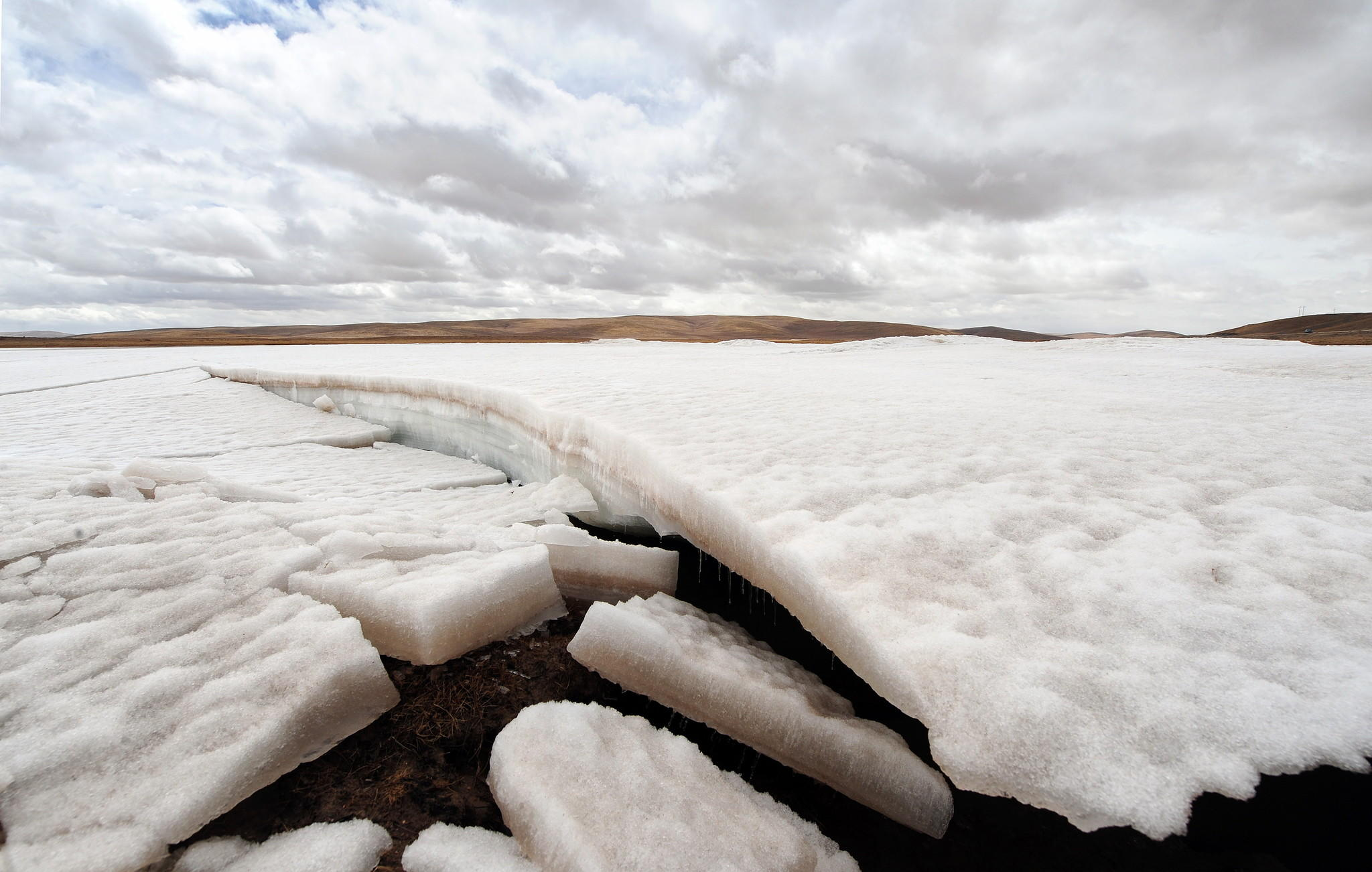 "Ice melts in the source region of China's Yellow River outside of Maduo on the Qinghai-Tibet plateau, known as the ""Roof of the World"", in 2010, in northwestern Qinghai province."