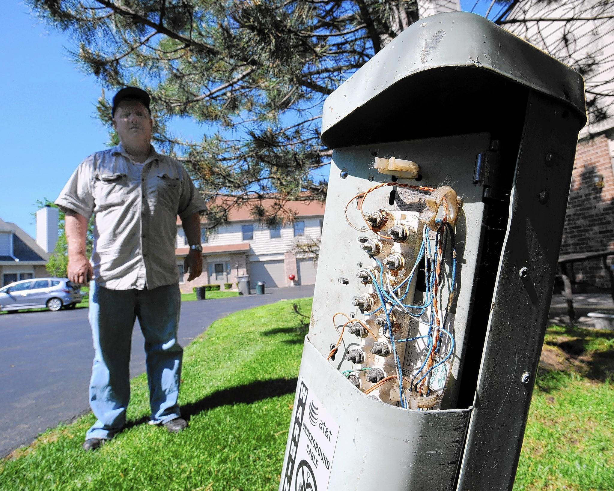 Robert Donahue says he had trouble getting AT&T to fix three utility boxes with exposed wires near the Orland Park condominium complex where he lives.