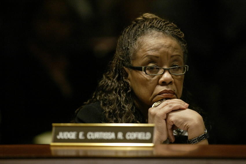 Judge Curtissa Cofield listens to testimony during her hearing before the Judicial Review Council in February 2009 after being arrested on DUI charges.