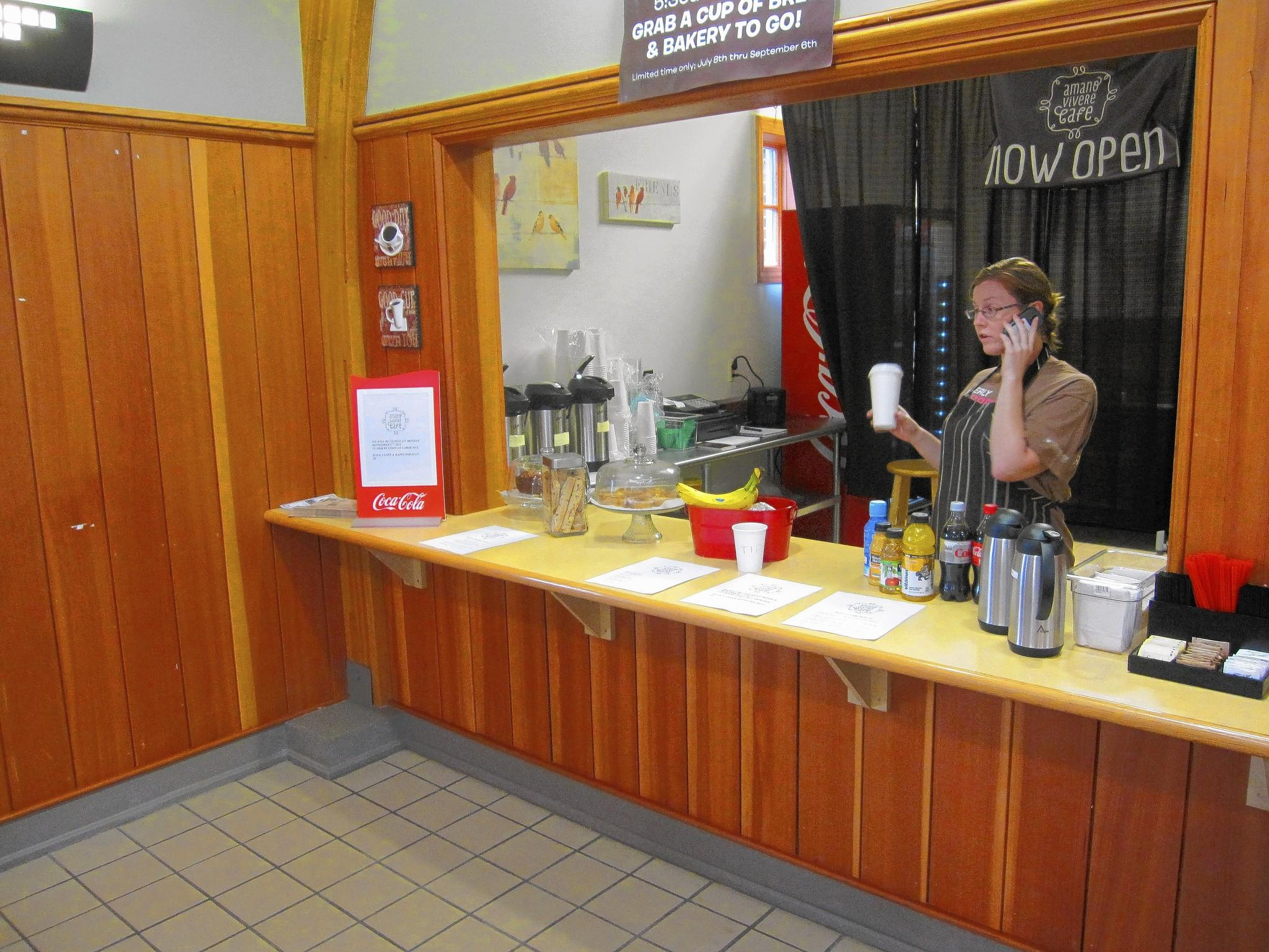Rita Murphy sells coffee at the concession counter inside the 143rd Street Metra Station in Orland Park. The counter is operated by nearby Amano Vivere Cafe.