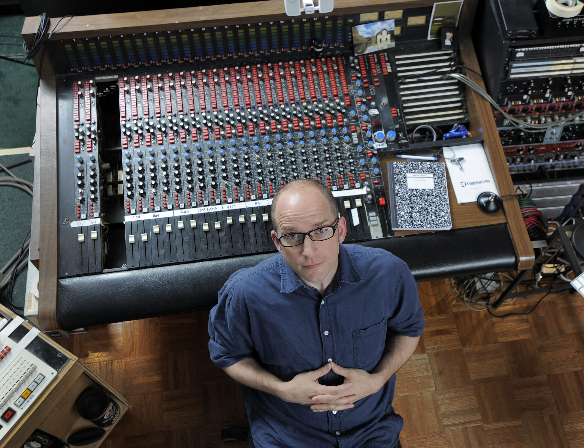 Baltimore music producer J. Robbins sits behind the boards at the Magpie Cage recording studio in Johnston Square.