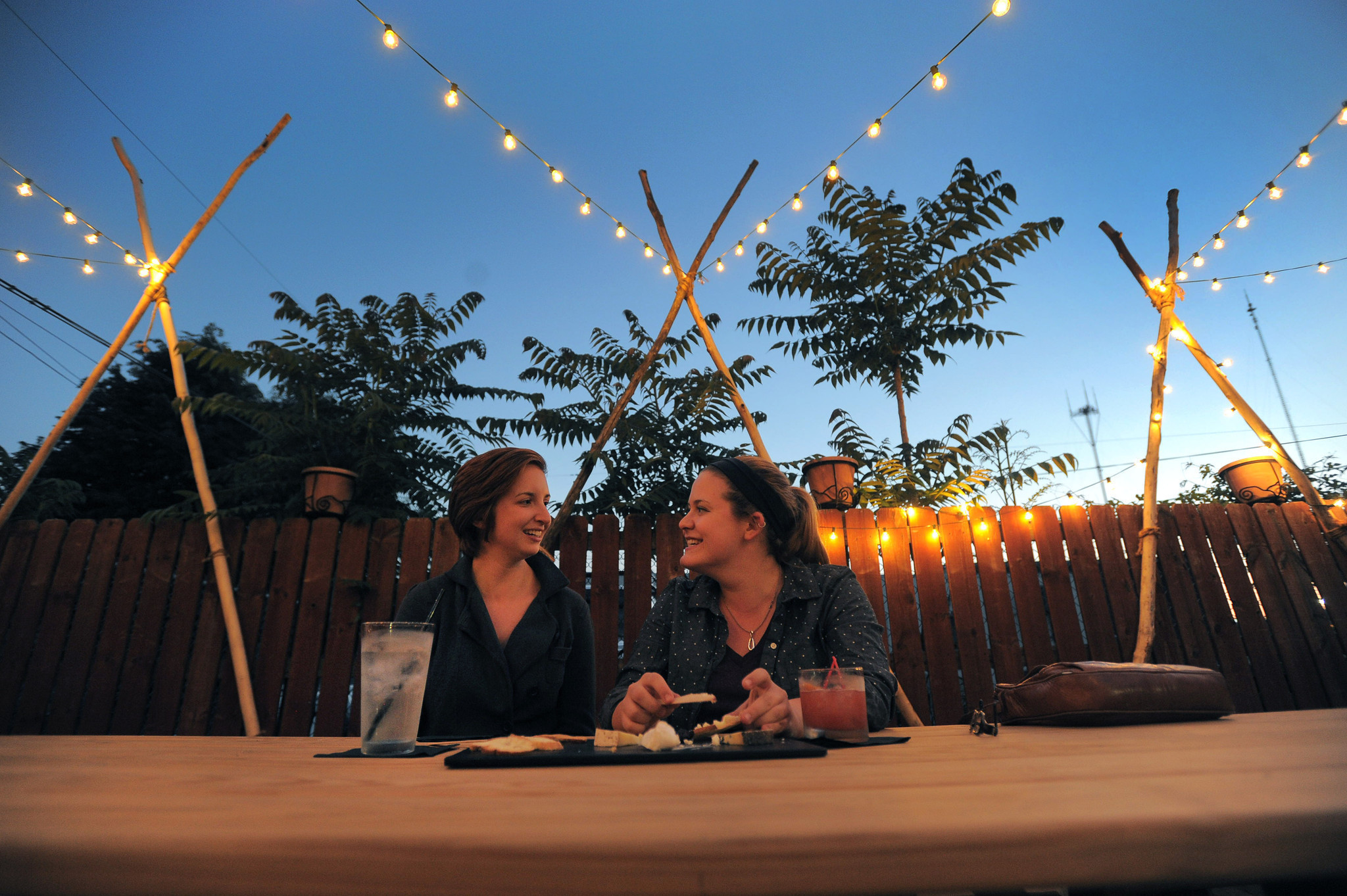Helen Hopper (left) and Kate Nelson of Baltimore sit in Blue Pit BBQ's backyard on a recent Friday night.