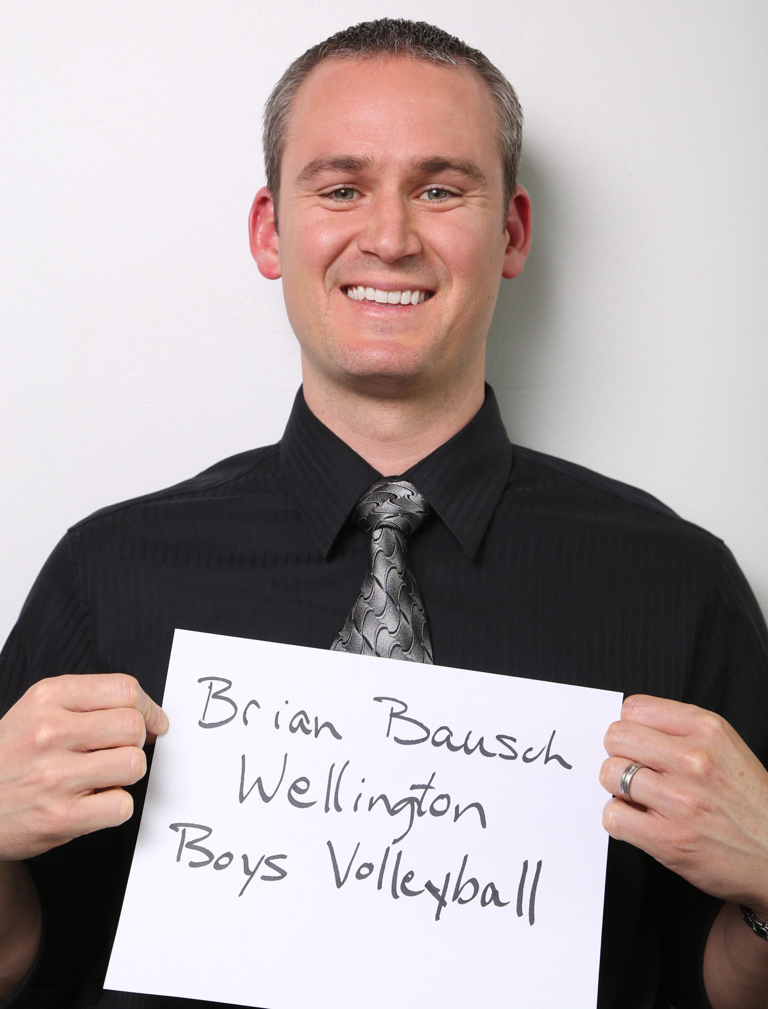 Wellington's Brian Bausch is the Boys Volleyball Coach of the Year