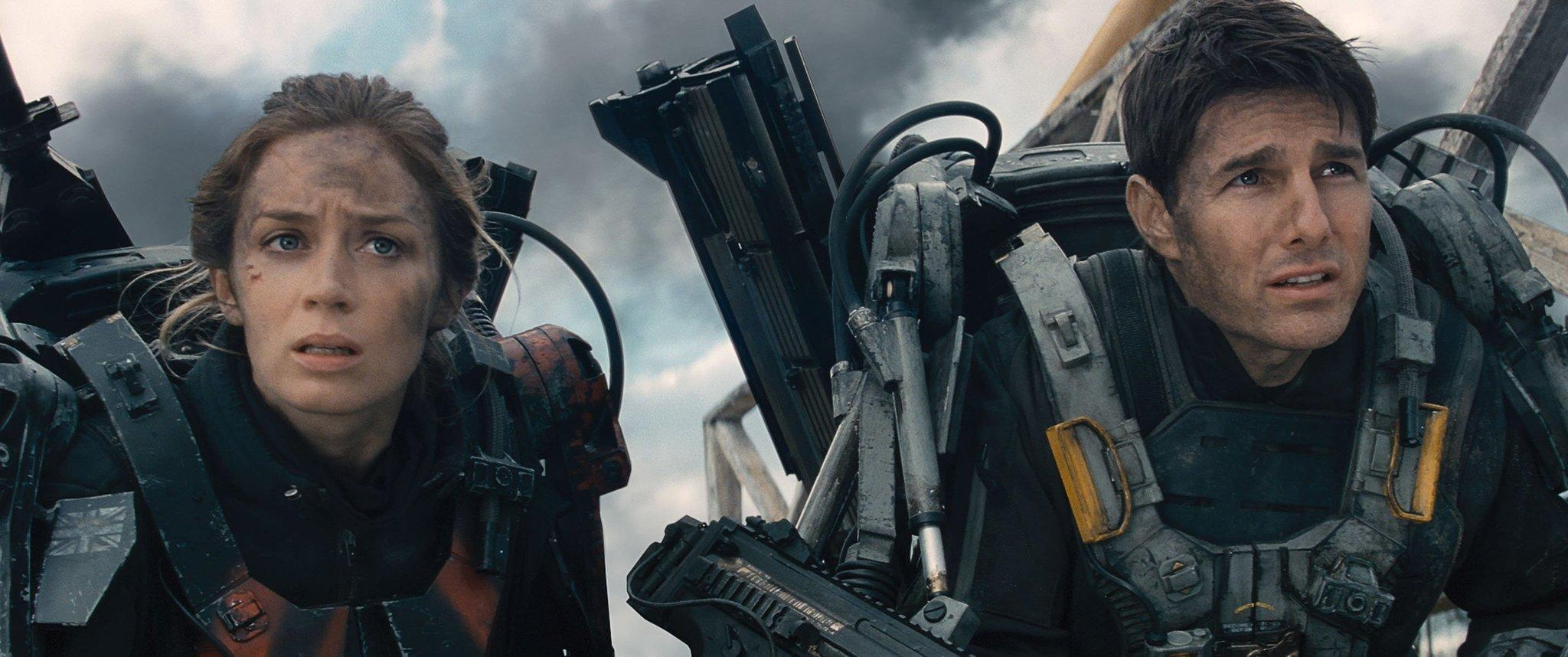 "Emily Blunt, left, as Rita and Tom Cruise as Cage in Warner Bros. Pictures' and Village Roadshow Pictures' sci-fi thriller ""Edge of Tomorrow."""