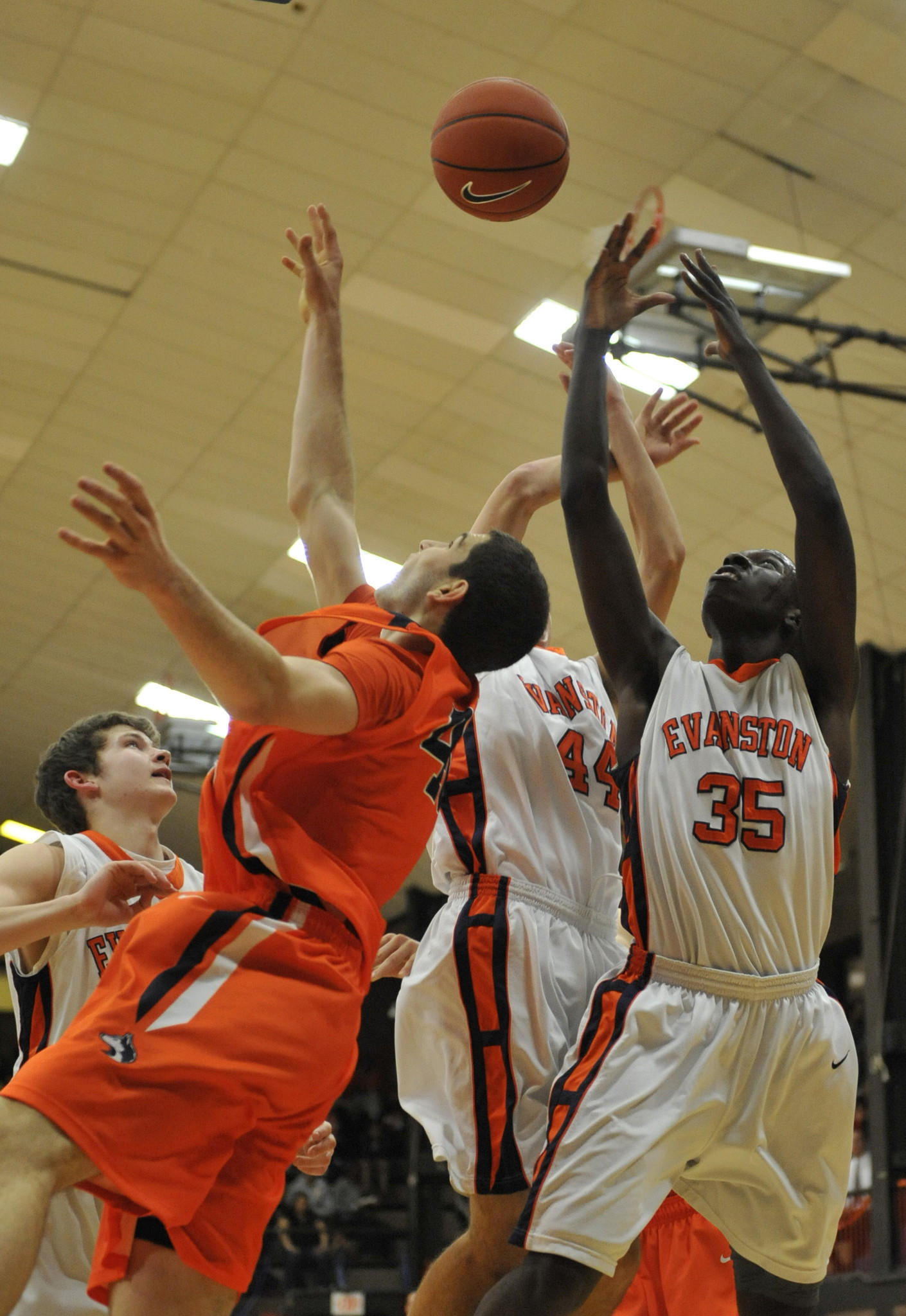 Evanston's Terrell Farmby (35) and Oak Park's Gabe Levin (left) go for a rebound during a January, 2012 game.