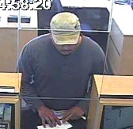 Surveillance photo of a man who robbed the North Community Bank branch at 2758 W. Belmont Ave. on Tuesday.