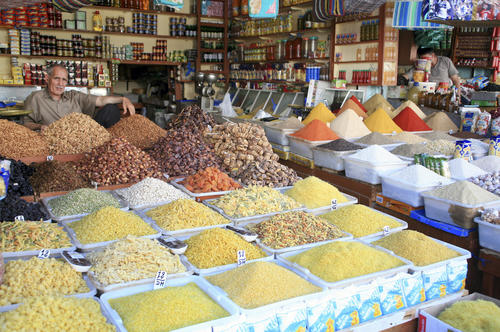Marrakesh ranked last for family-friendliness, public transport, and nightlife. Here sits a spices and Pasta Market Stall in Marrakesh, Morocco.