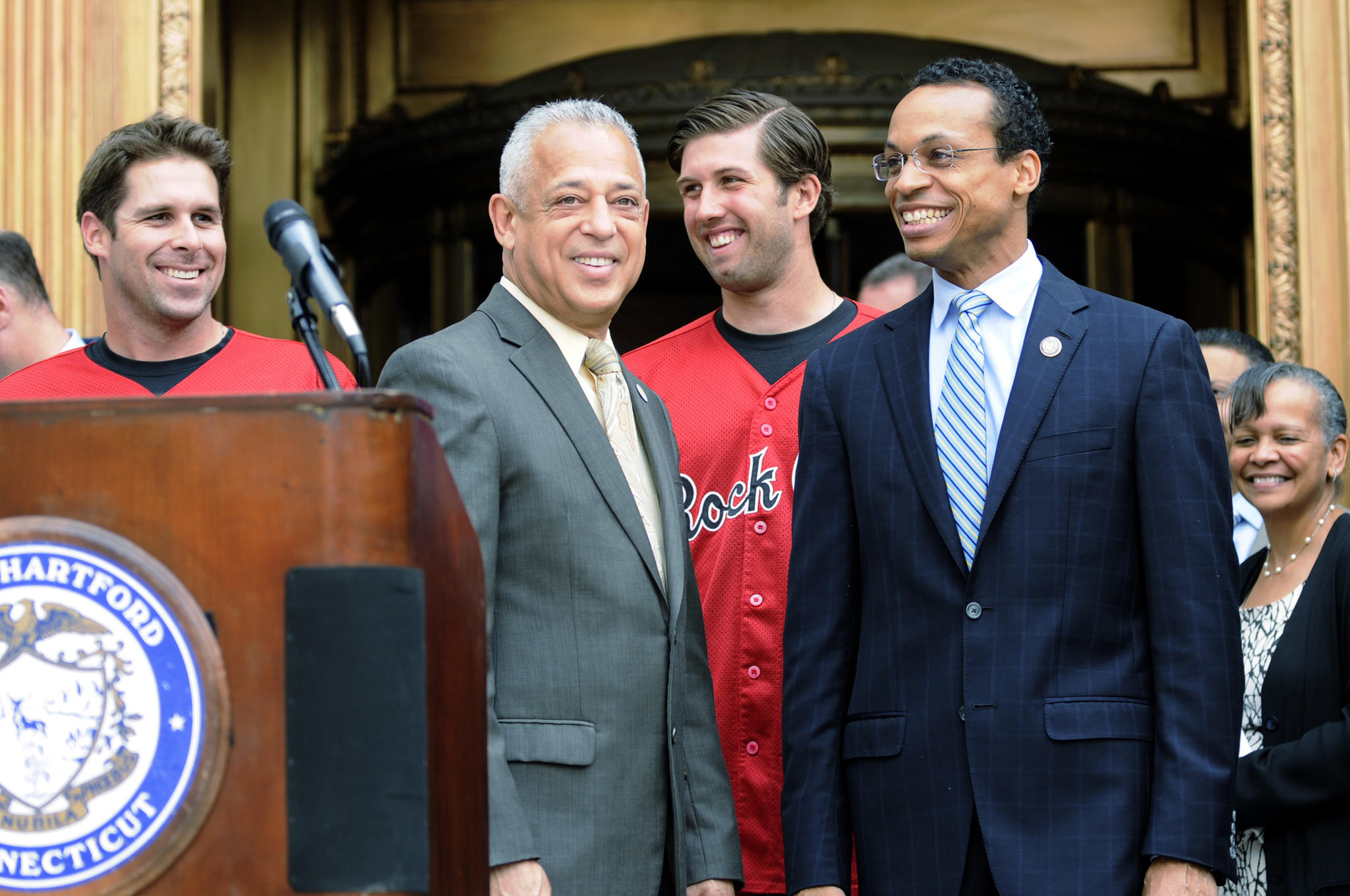 Hartford Mayor Pedro Segarra (second from left) along with Rock Cats players Nate Hanson and Pat Dean, and Hartford Common Council President Shawn Woodin, are all smiles at the announcement of the city's plan to build a stadium for the team.