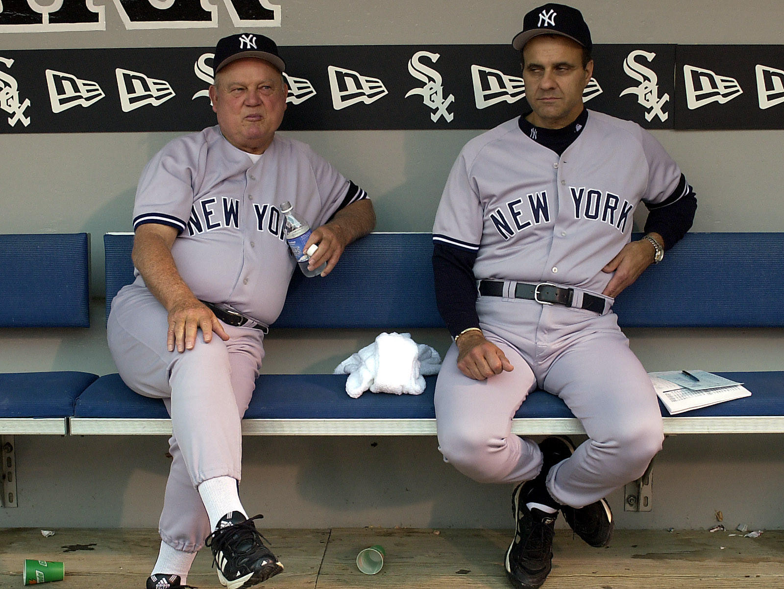 Yankees coach Don Zimmer with manager Joe Torre sit in the dugout before game against the White Sox in 2000.