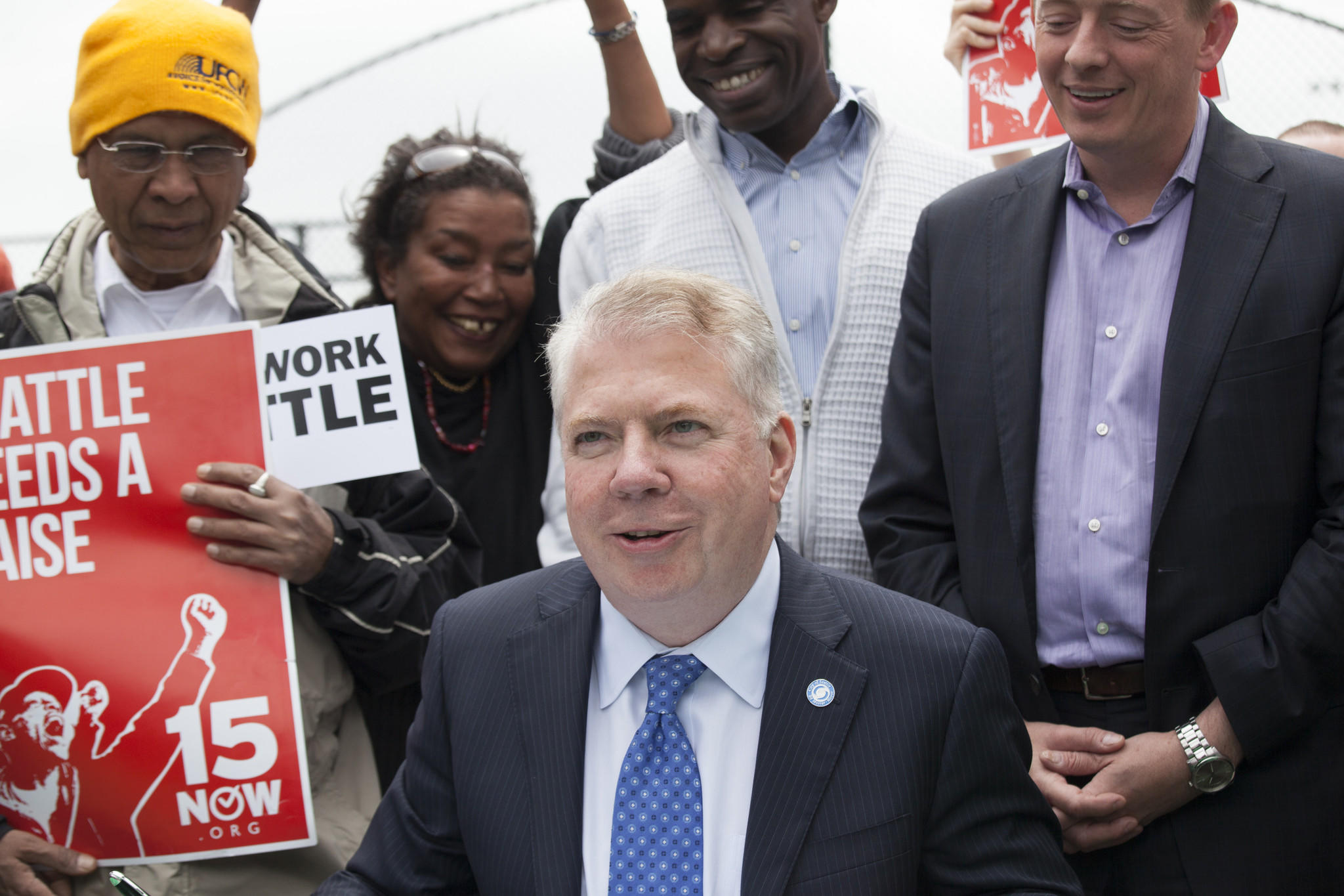 Seattle Mayor Ed Murray pauses while signing a bill that raises the city's minimum wage to $15 an hour.
