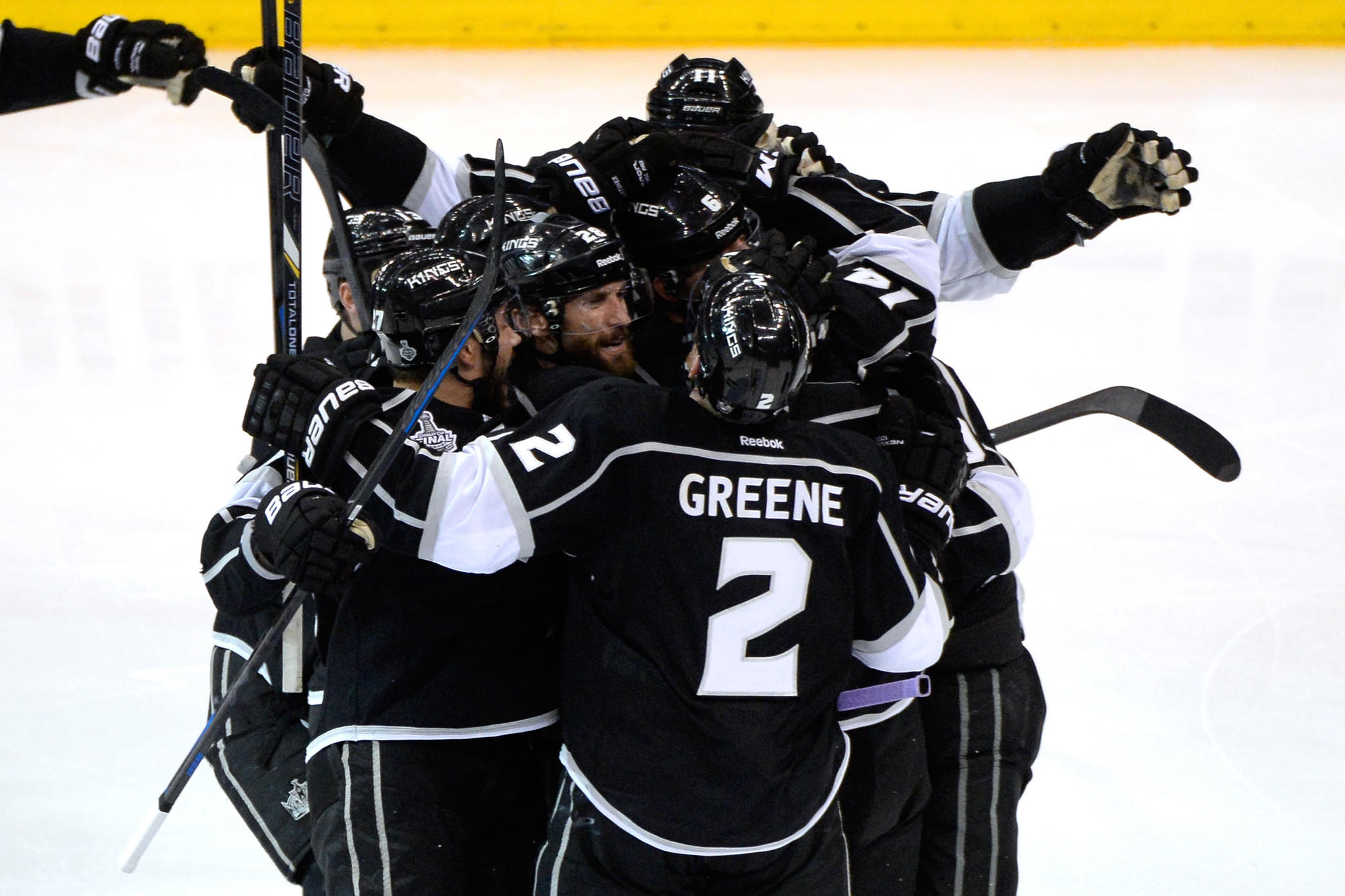 The Kings' Justin Williams and teammates celebrate his game-winning goal in OT.