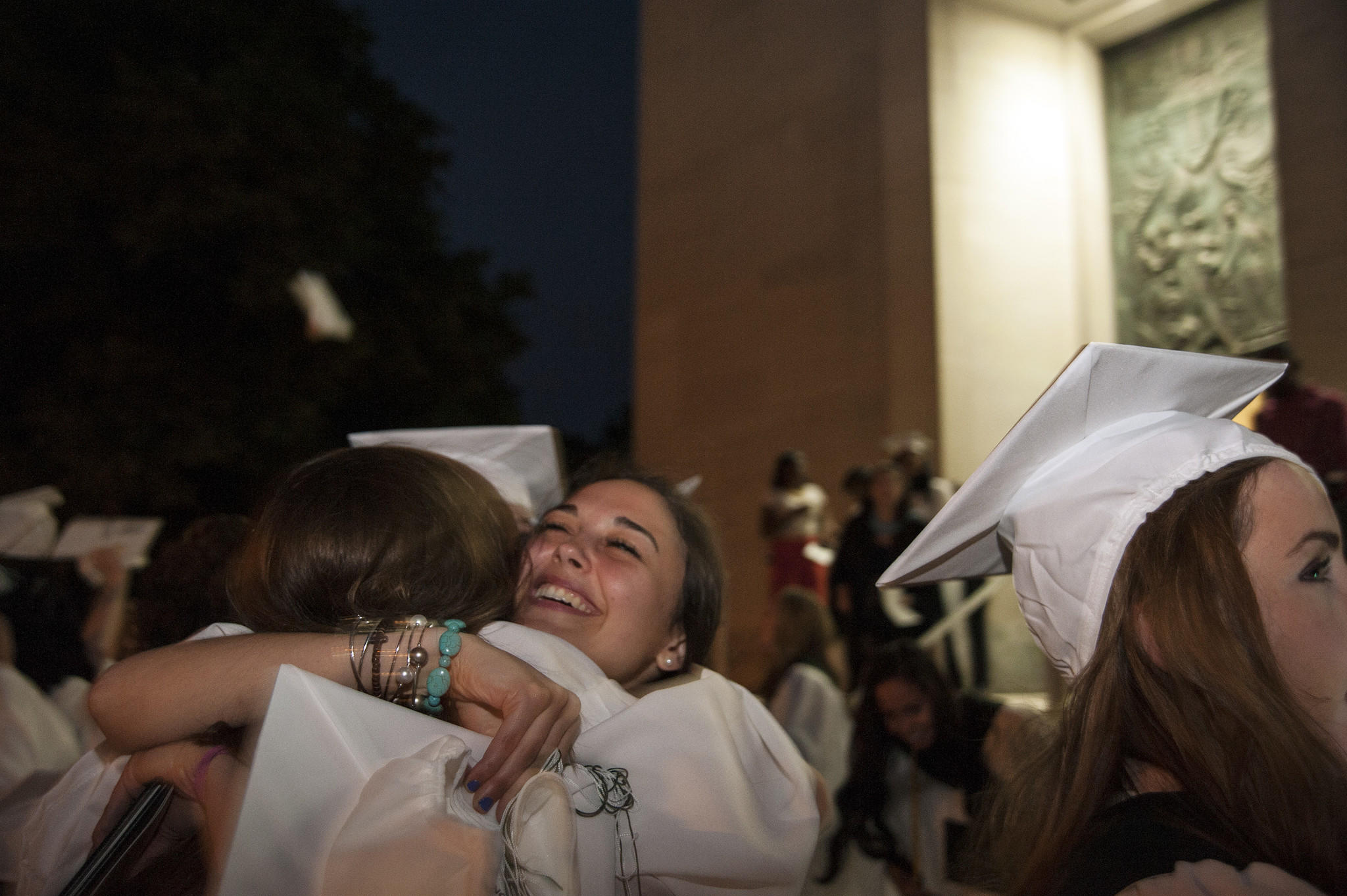 Madison Martinaro celebrates with her fellow graduating classmates from Northwest Catholic High School at the Cathedral of Saint Joseph in Hartford on Wednesday evening.