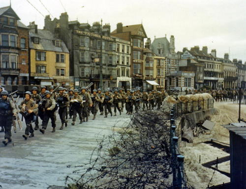 The 2nd Battalion U.S. Army Rangers, tasked with capturing the German heavy coastal defense battery at Pointe du Hoc to the west of the D-Day landing zone of Omaha Beach, march to their landing craft in Weymouth, England, on June 5, 1944.