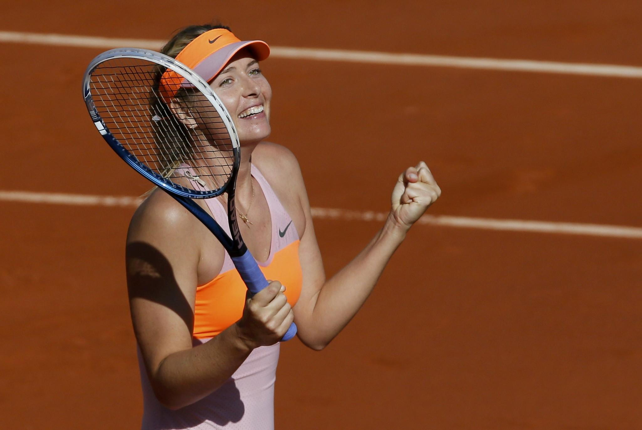 Maria Sharapova of Russia reacts after winning her women's semifinal match against Eugenie Bouchard of Canada at the French Open.