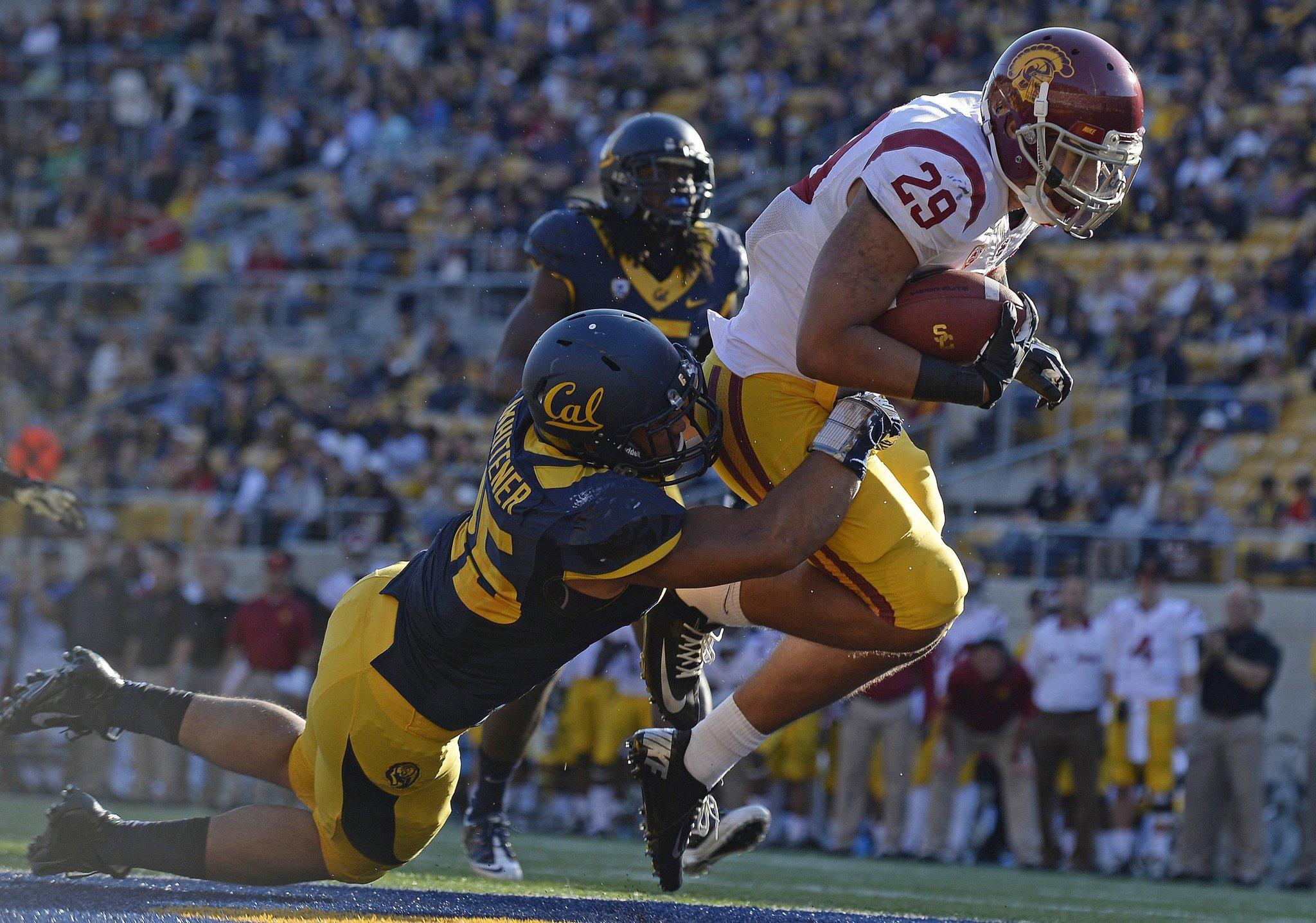 Ty Isaac of Southern California scores a 4-yard touchdown as Chad Whitener of California tackles from behind.