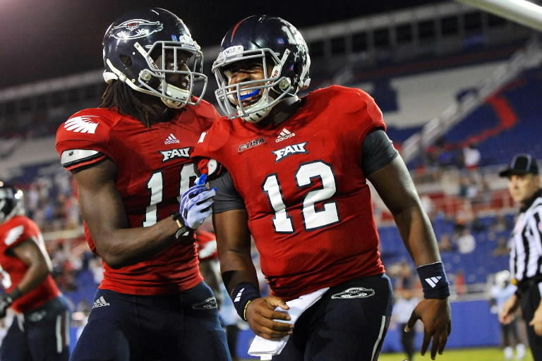 Florida Atlantic Owls quarterback Jaquez Johnson (right) celebrates his touchdown with teammate wide receiver William Dukes (left) during the fourth quarter at FAU Football Stadium.