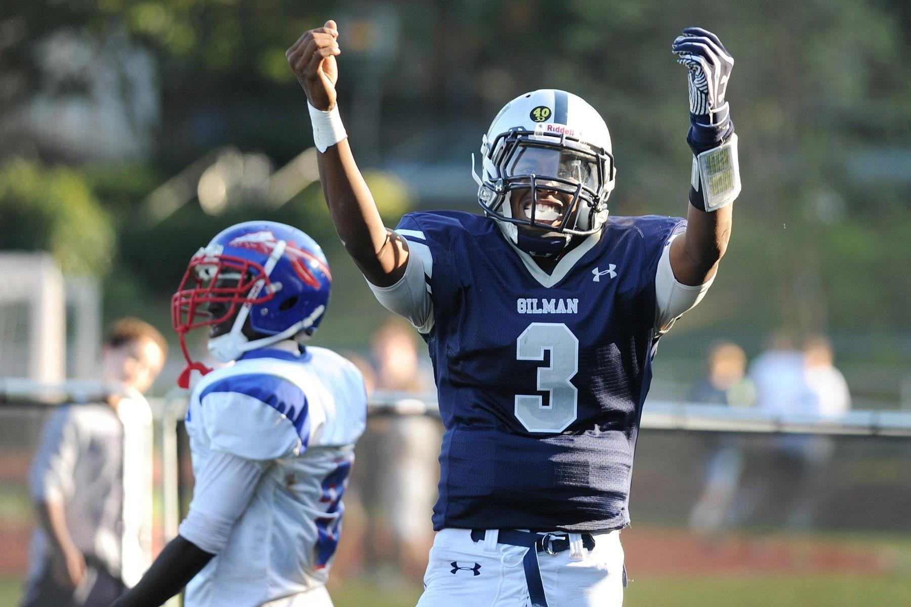 Gilman quarterback Kai Locksley celebrates a long run for a touchdown late in the second quarter during a game against Anacostia.