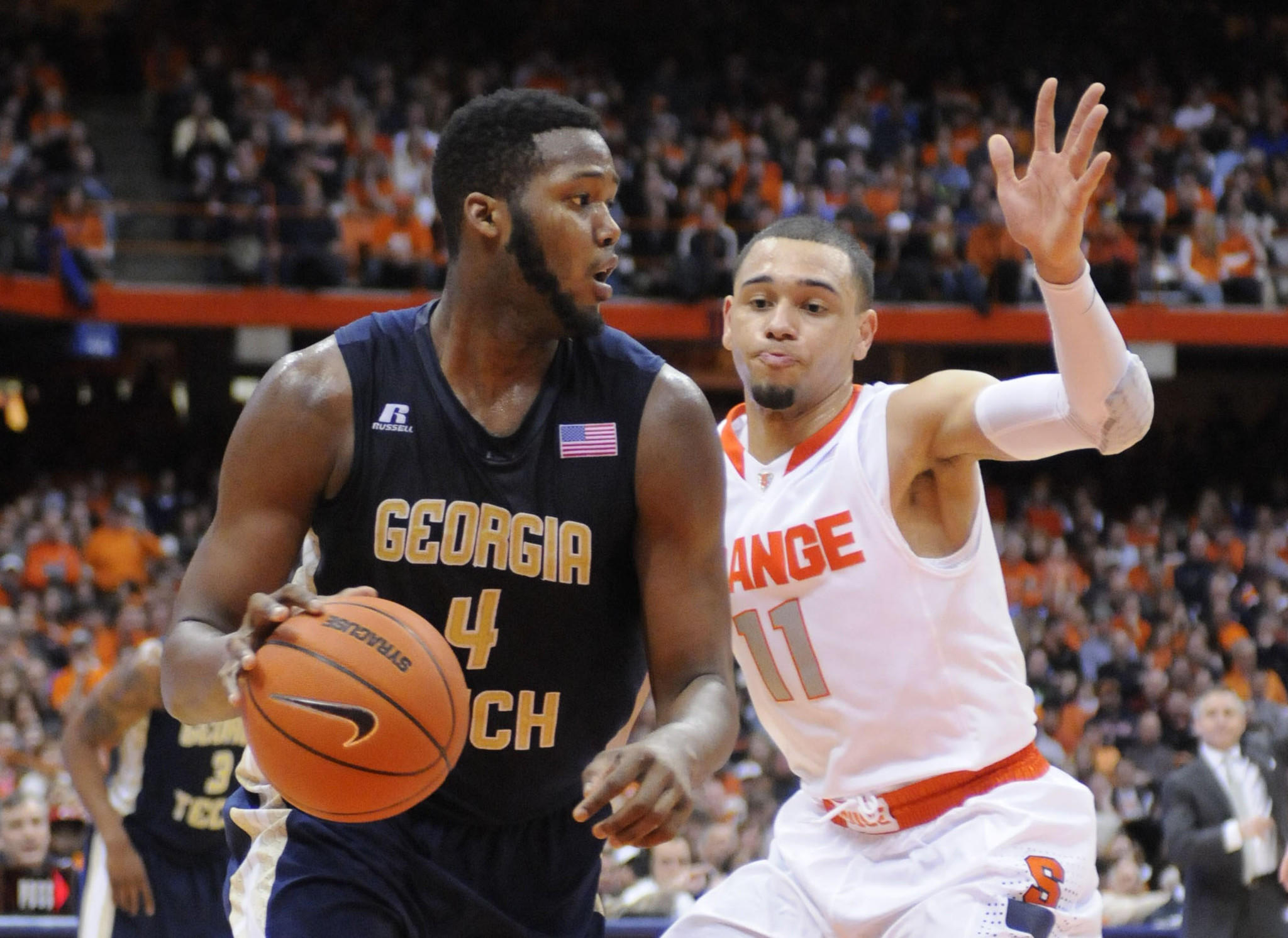 Former Georgia Tech forward Robert Carter dribbles past Syracuse guard Tyler Ennis during a game in March.