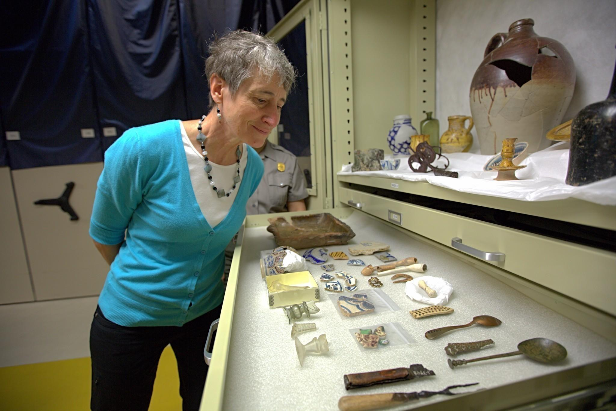 U.S. secretary of interior Sally Jewell visits Jamestown Island historic sites. Jewell inspects some of the artifacts stored at Jamestown's Historic Park.