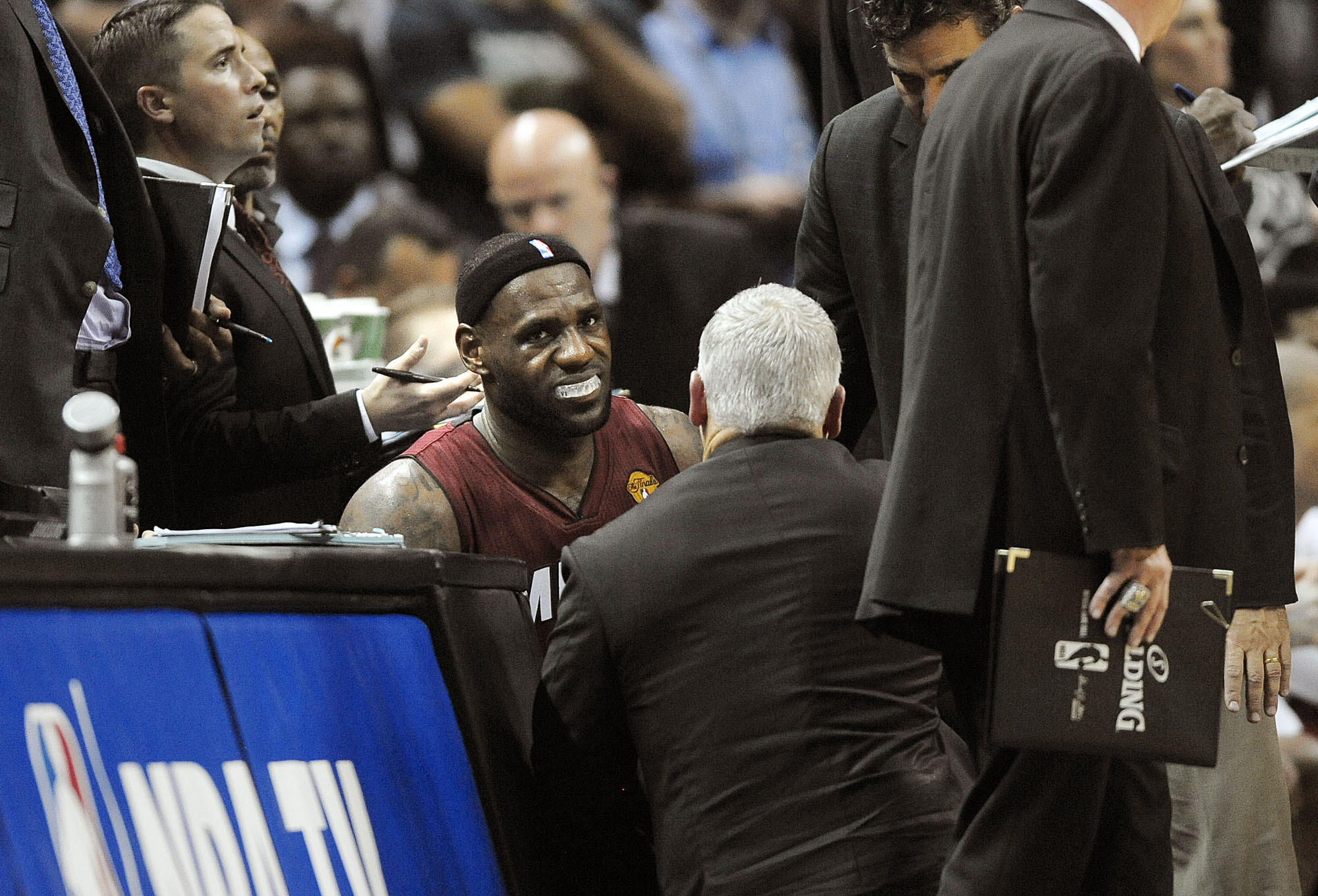 Miami Heat forward LeBron James is treated on the bench after hurting his leg during the second half of Game 1 of the NBA Finals against the San Antonio Spurs, Thursday, June 5, 2014 at AT&T Center. Michael Laughlin, South Florida Sun Sentinel