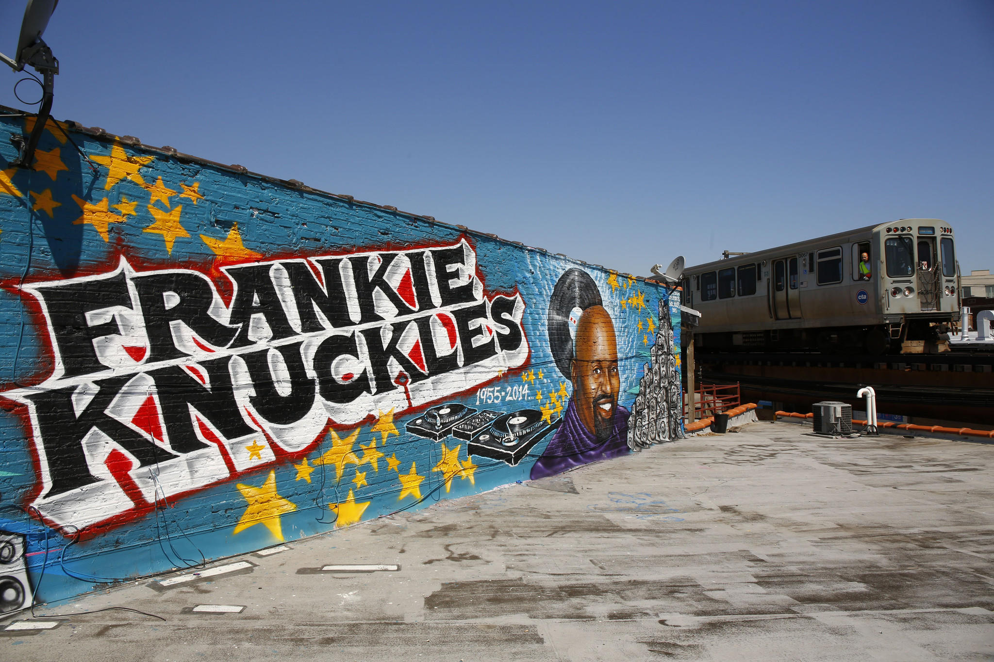 A mural honoring music legend Frankie Knuckles is displayed along the CTA Blue Line in the 2900 block of West Fullerton Avenue in the Logan Square neighborhood.