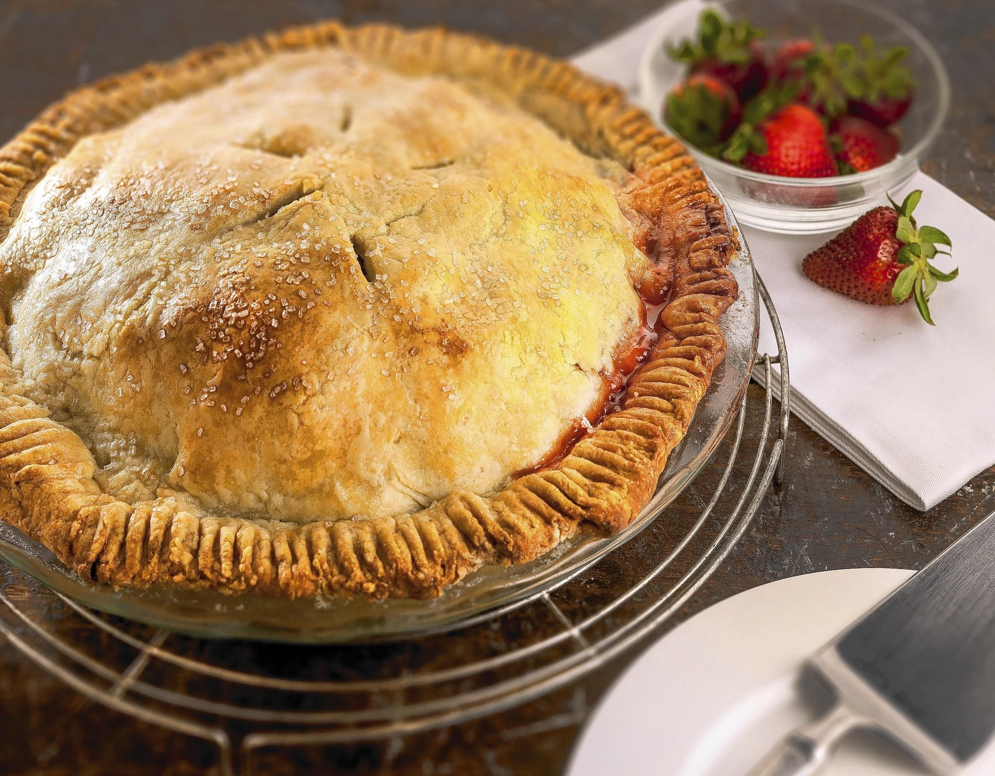 A finished dish photo of strawberry and rhubarb pie recipe.