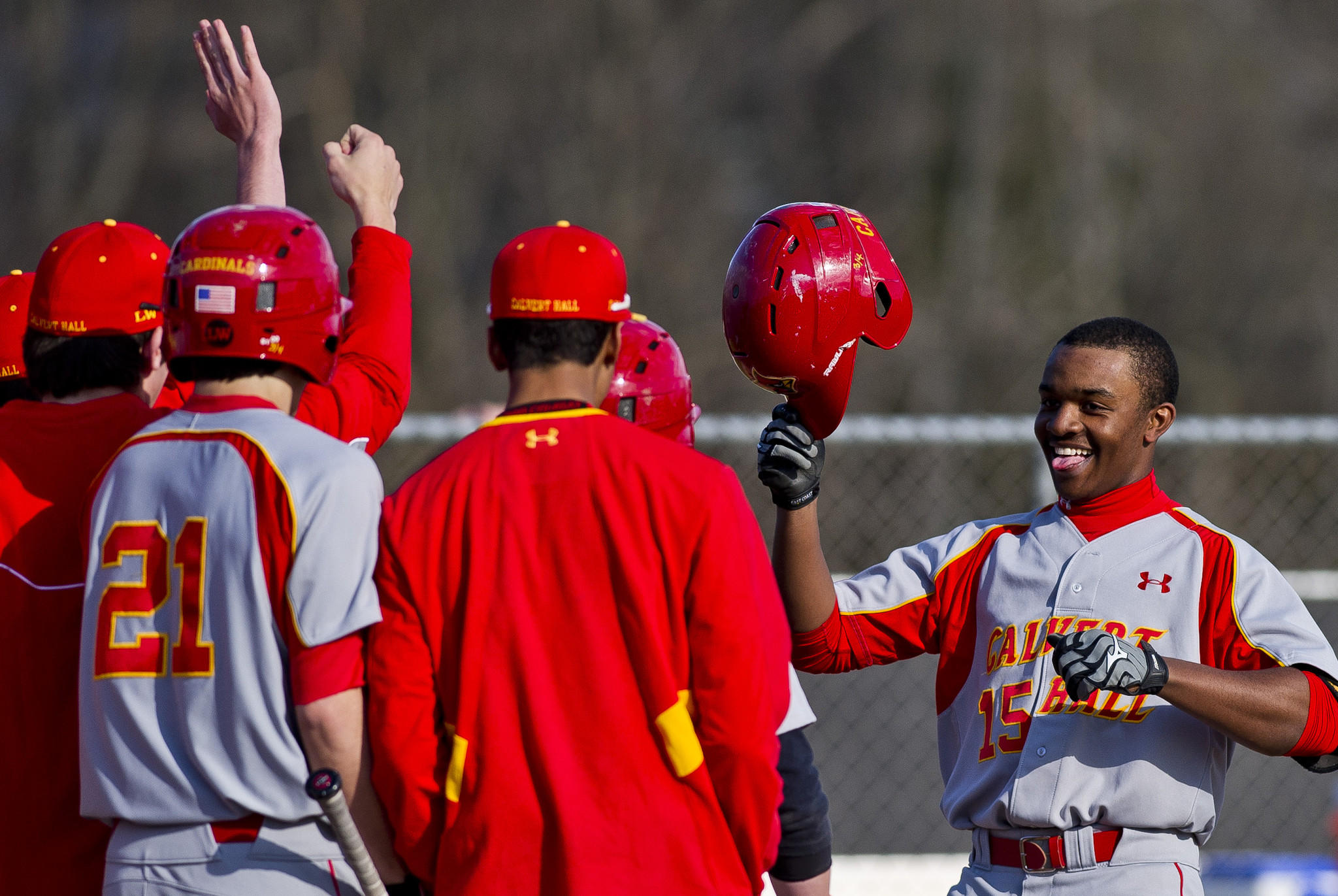 Calvery Hall's Troy Stokes, right, is congratulated by teammates after hitting a grand slam against Gilman.