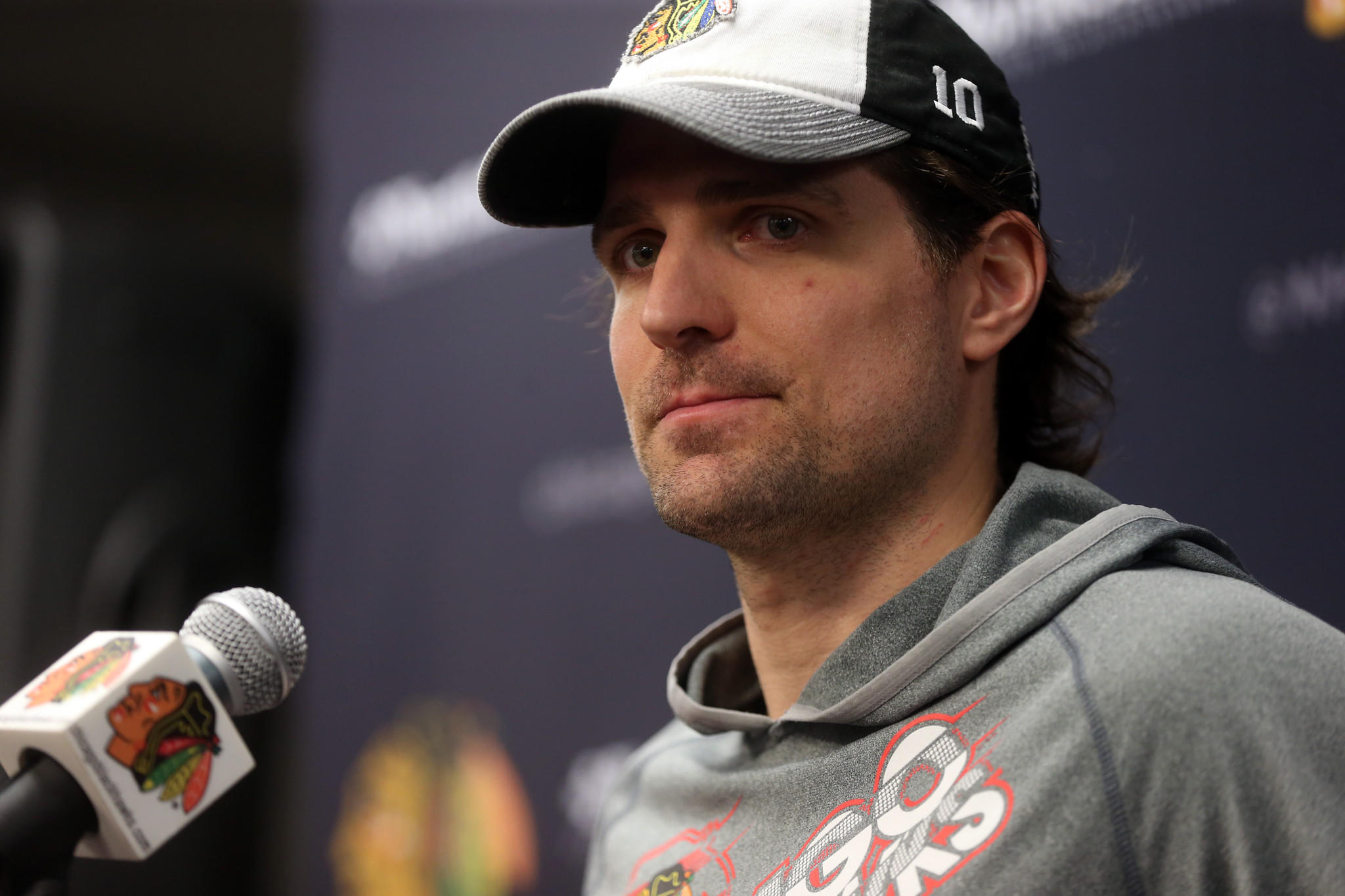 Patrick Sharp talks to the media at the United Center Tuesday.