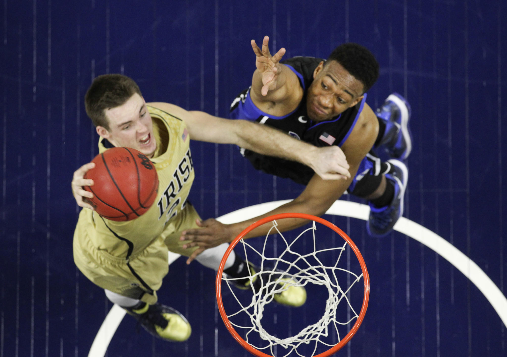 During a game in January, Duke's Jabari Parker (right) attempts to block Notre Dame forward Pat Connaughton.