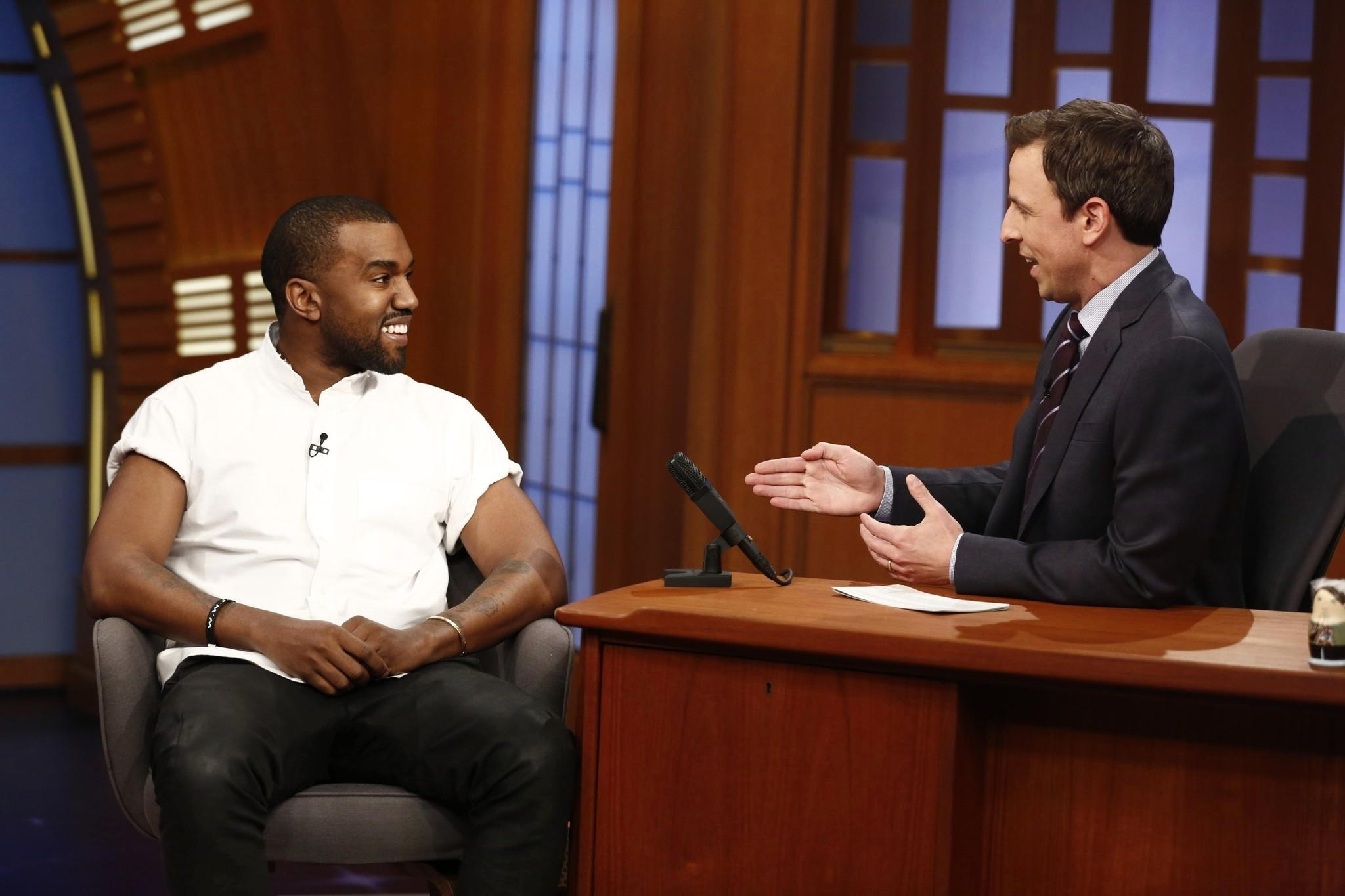"Kanye West sits for an interview with host Seth Meyers during NBC's ""Late Night with Seth Meyers"" on February 25, 2014 in New York City."
