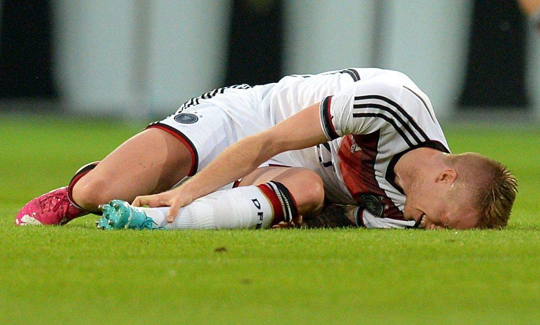 Germany's Marco Reus lies injured during a friendly between Germany and Armenia on Friday.