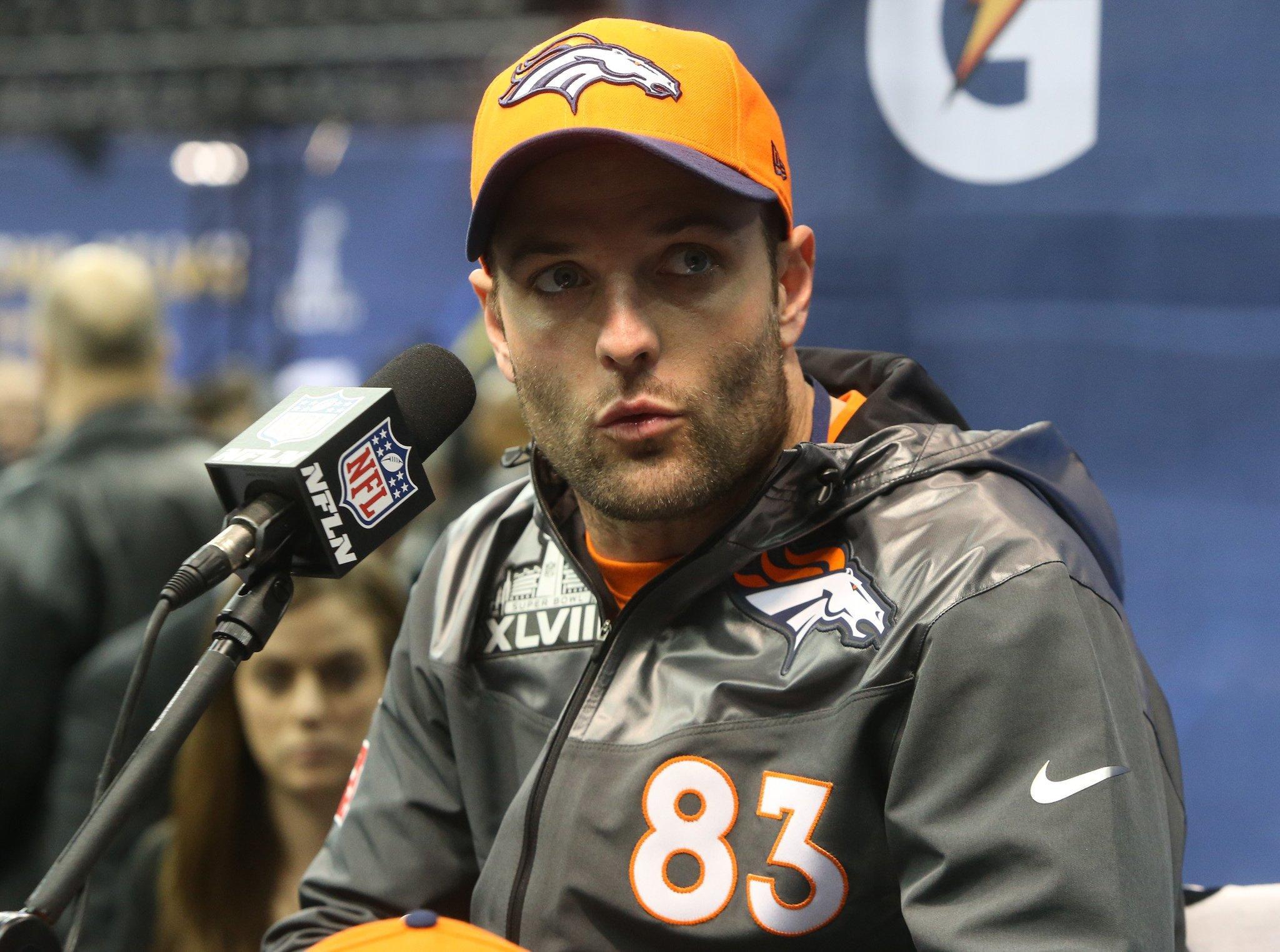 Wes Welker of the Denver Broncos talks during media day for Super Bowl XLVIII.