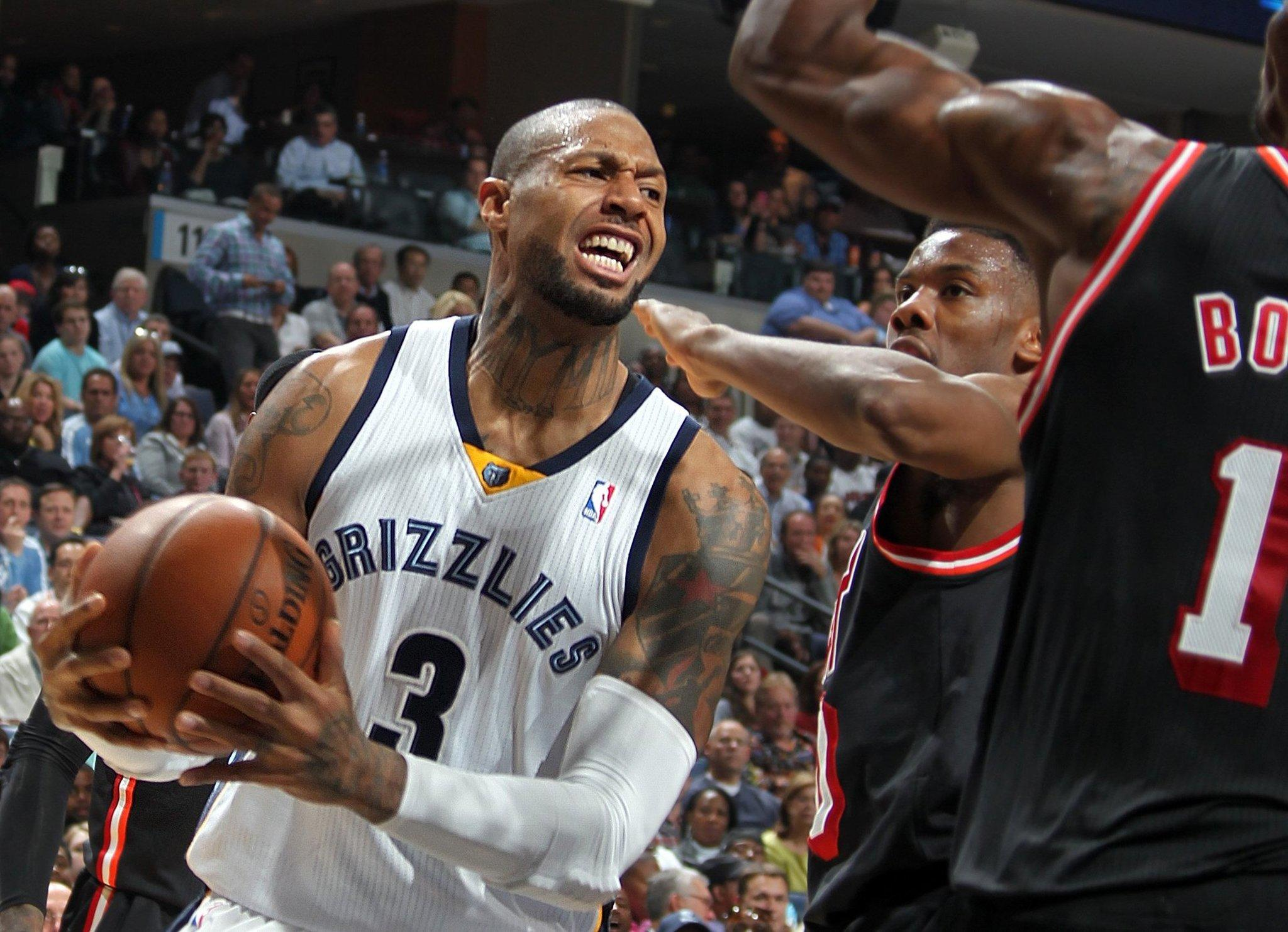 The Grizzlies' James Johnson (3) drives against the Heat in April.