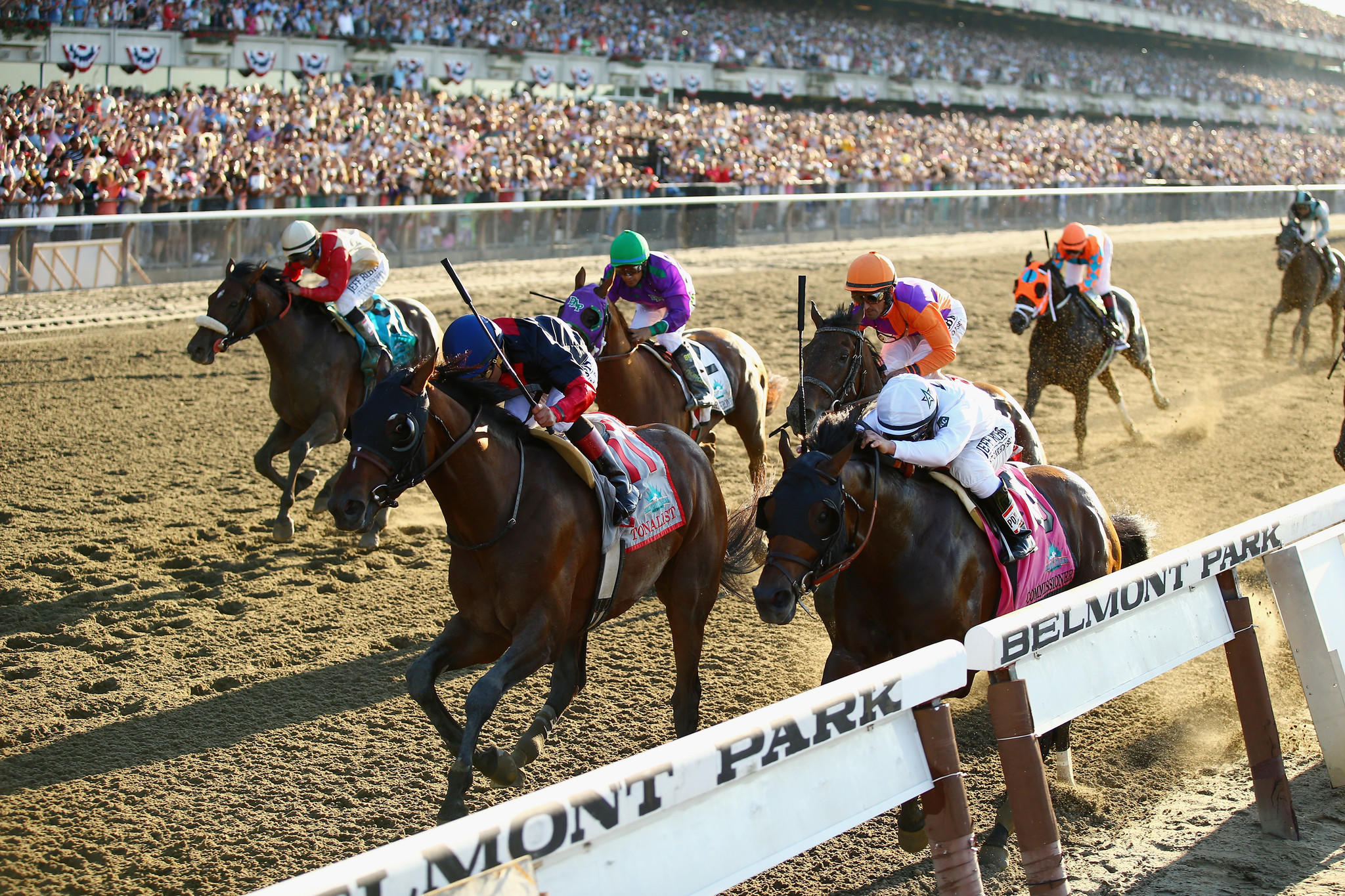 Tonalist, second from left, beats out California Chrome and the Belmont Stakes field for the third leg of the Triple Crown.